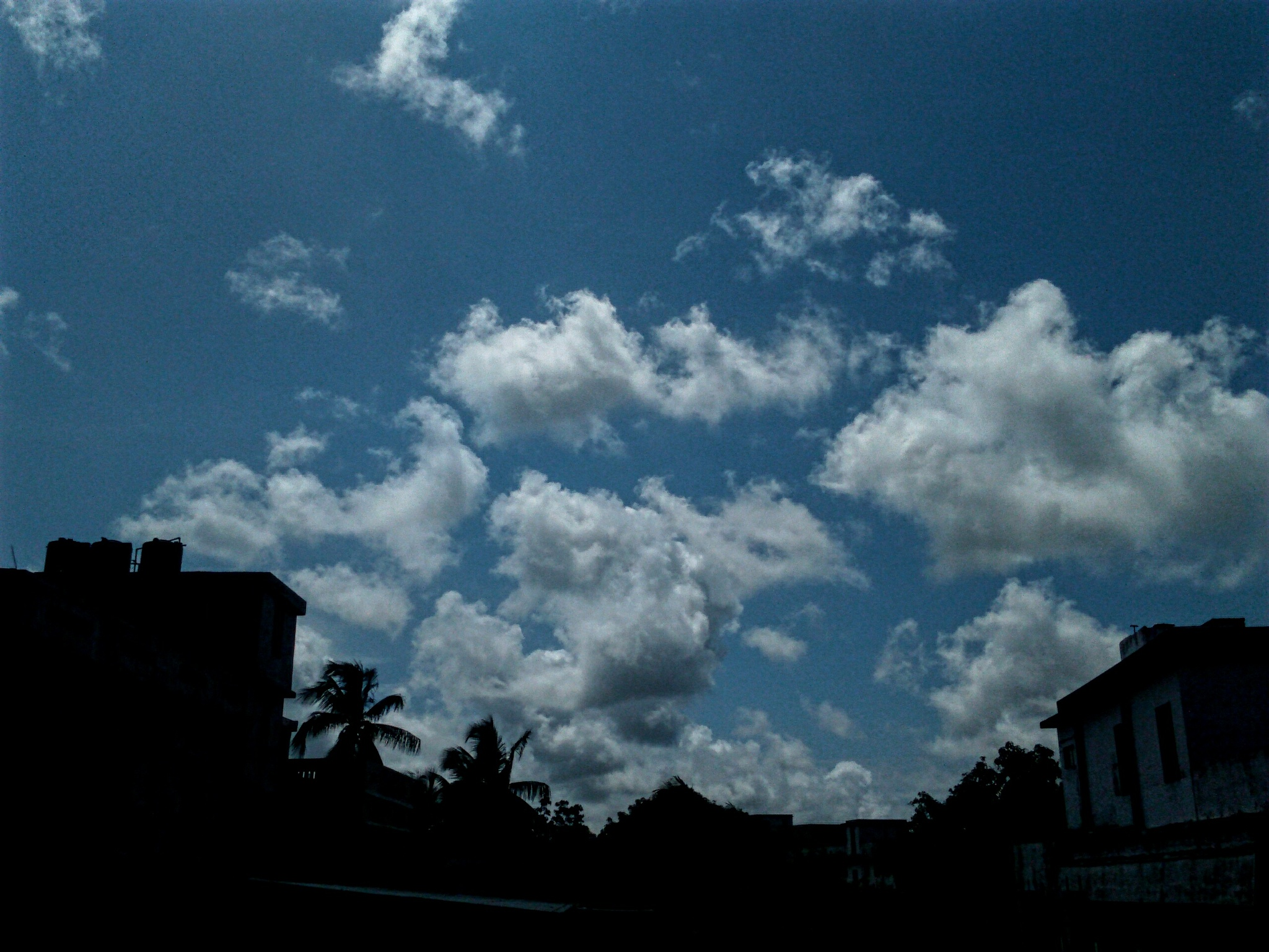 White clouds on blue sky  by soumitramaity39