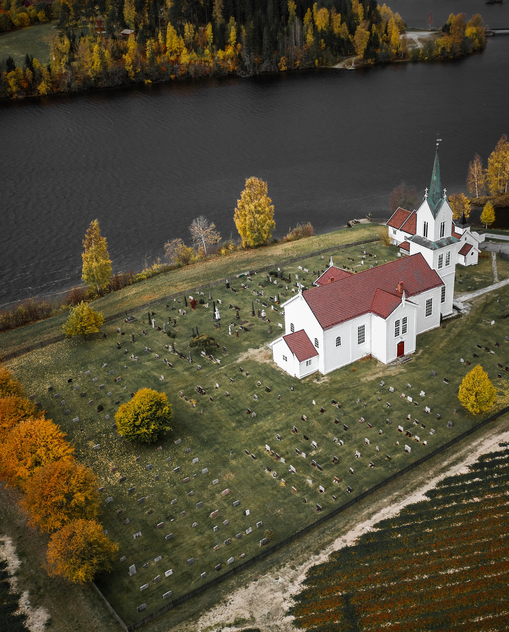 Norwegian church in beautiful autumn colors by Ole-Kristian Sverre