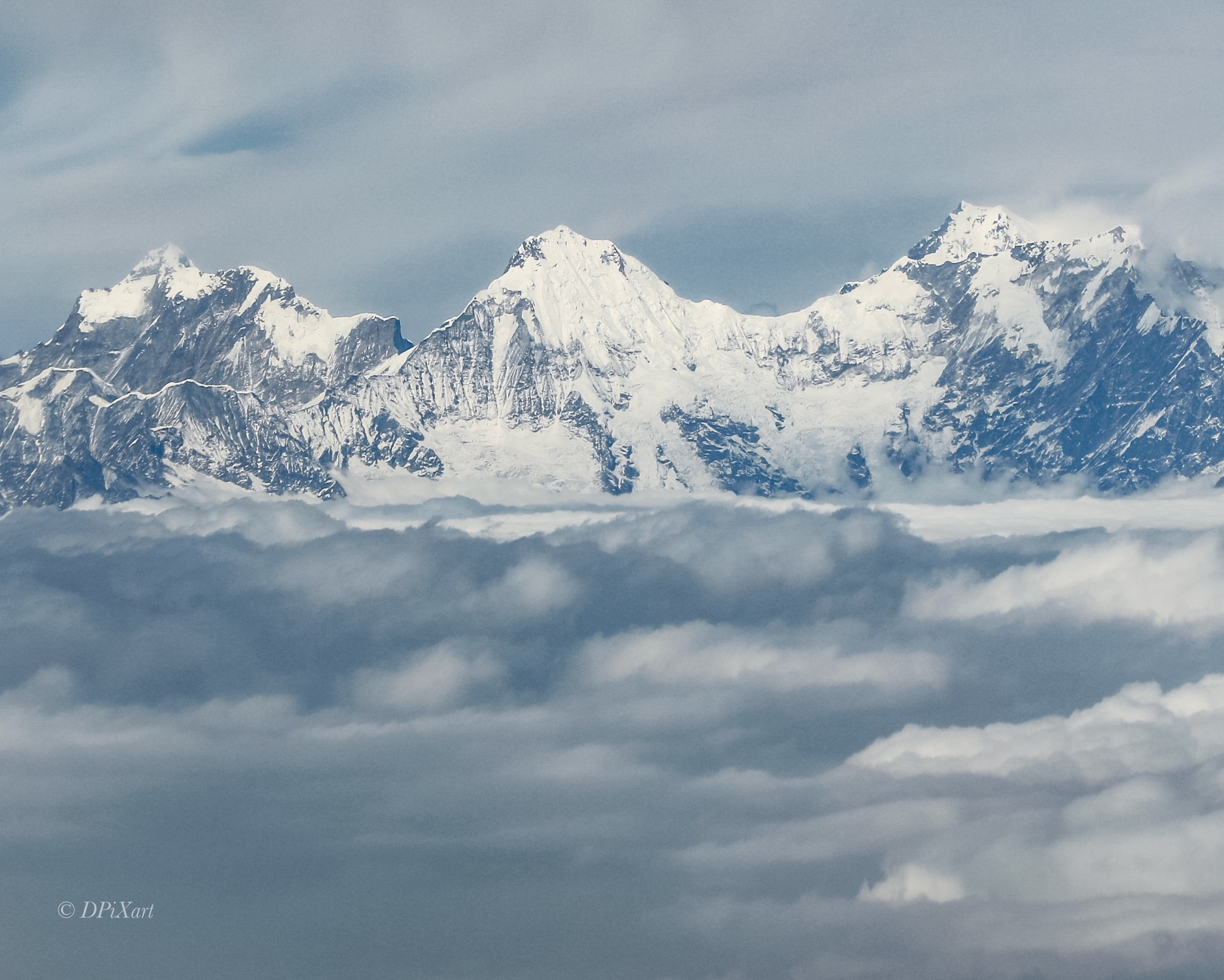 Himalayan peaks above cloud  by Dinesh Swamy