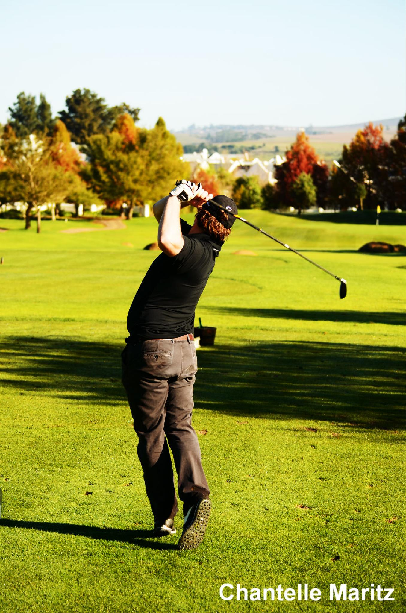 One of the golfers. by Chantelle Maritz