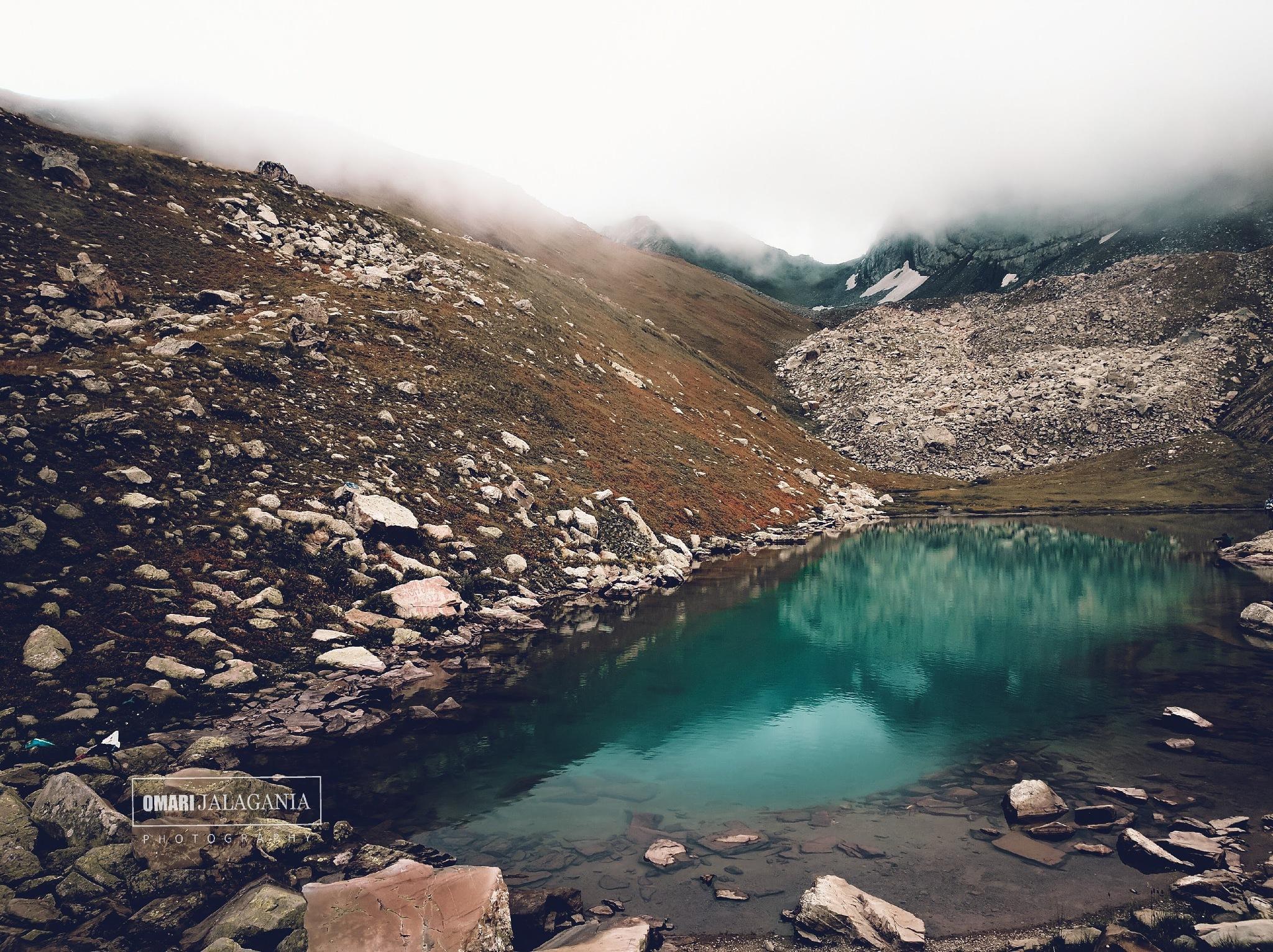 Lake in mountains by Omari Jalagania