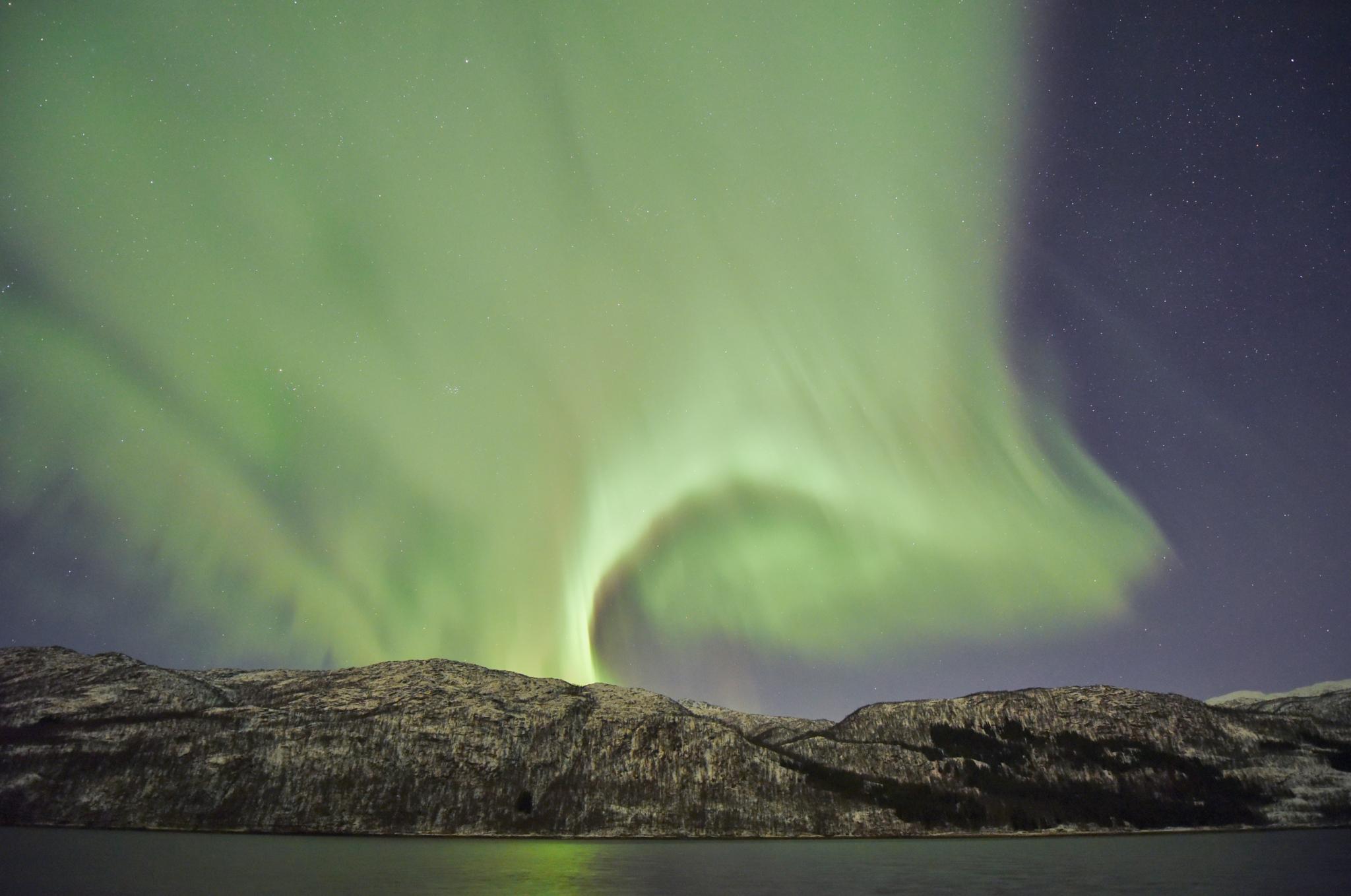 Green curl above the hill by E Pedersen