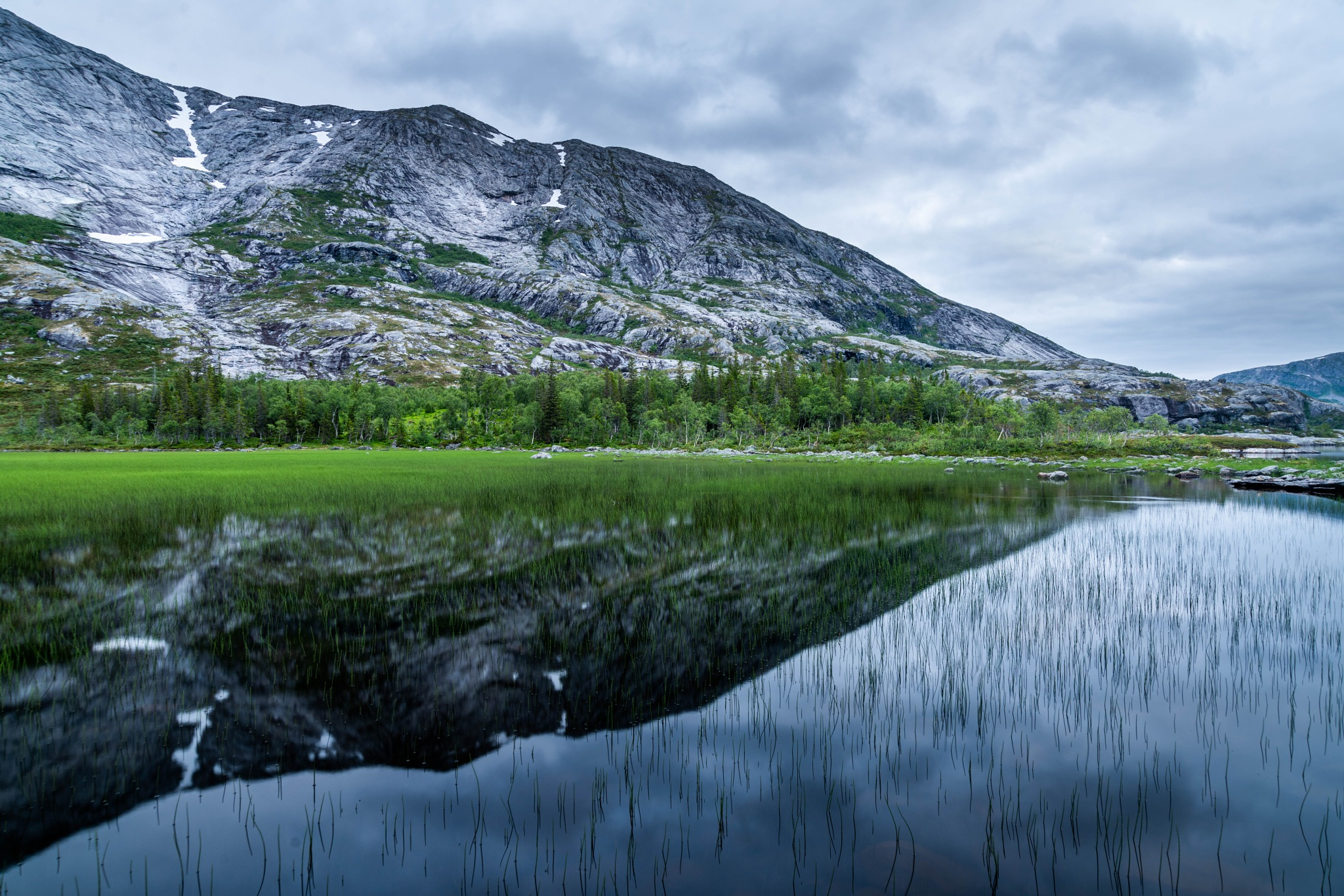 Reflections of some mountains in Helgeland by E Pedersen