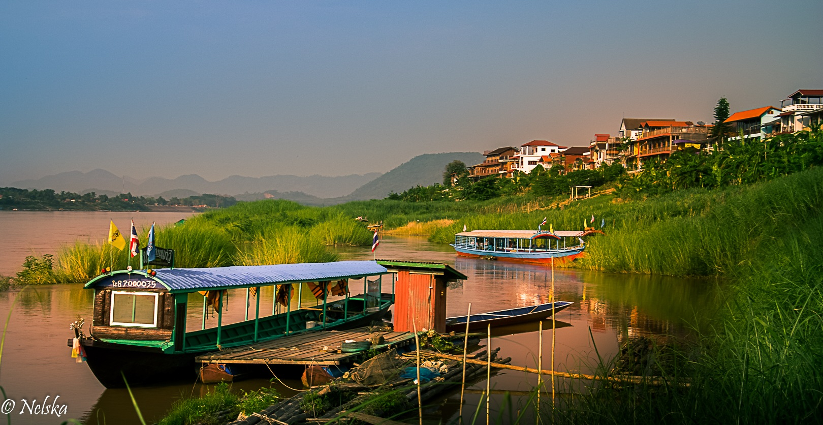 Sunset on the banks of the Mekong - North Thailand by Nelska