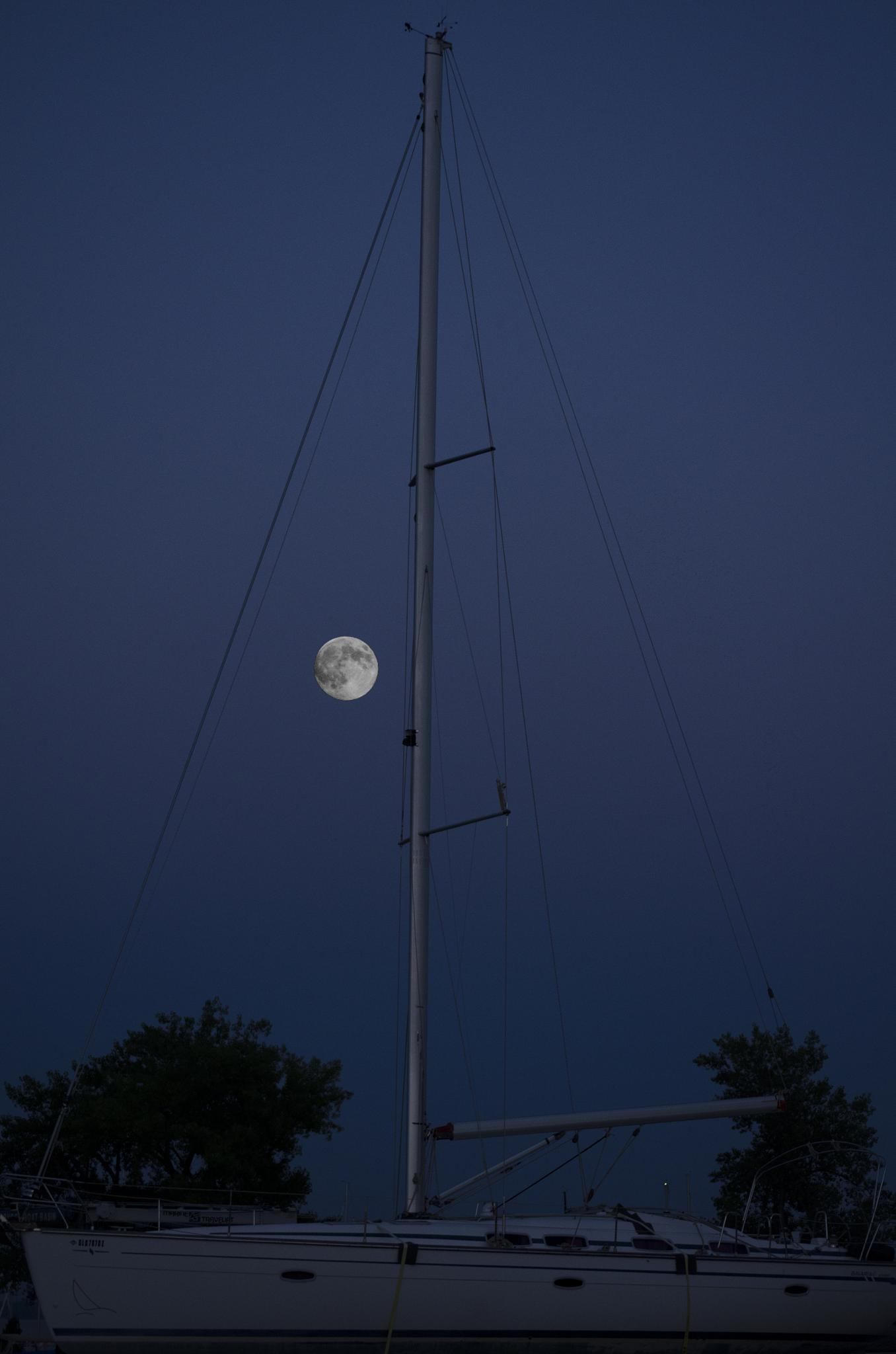 moon and sail boat by Michael Carter