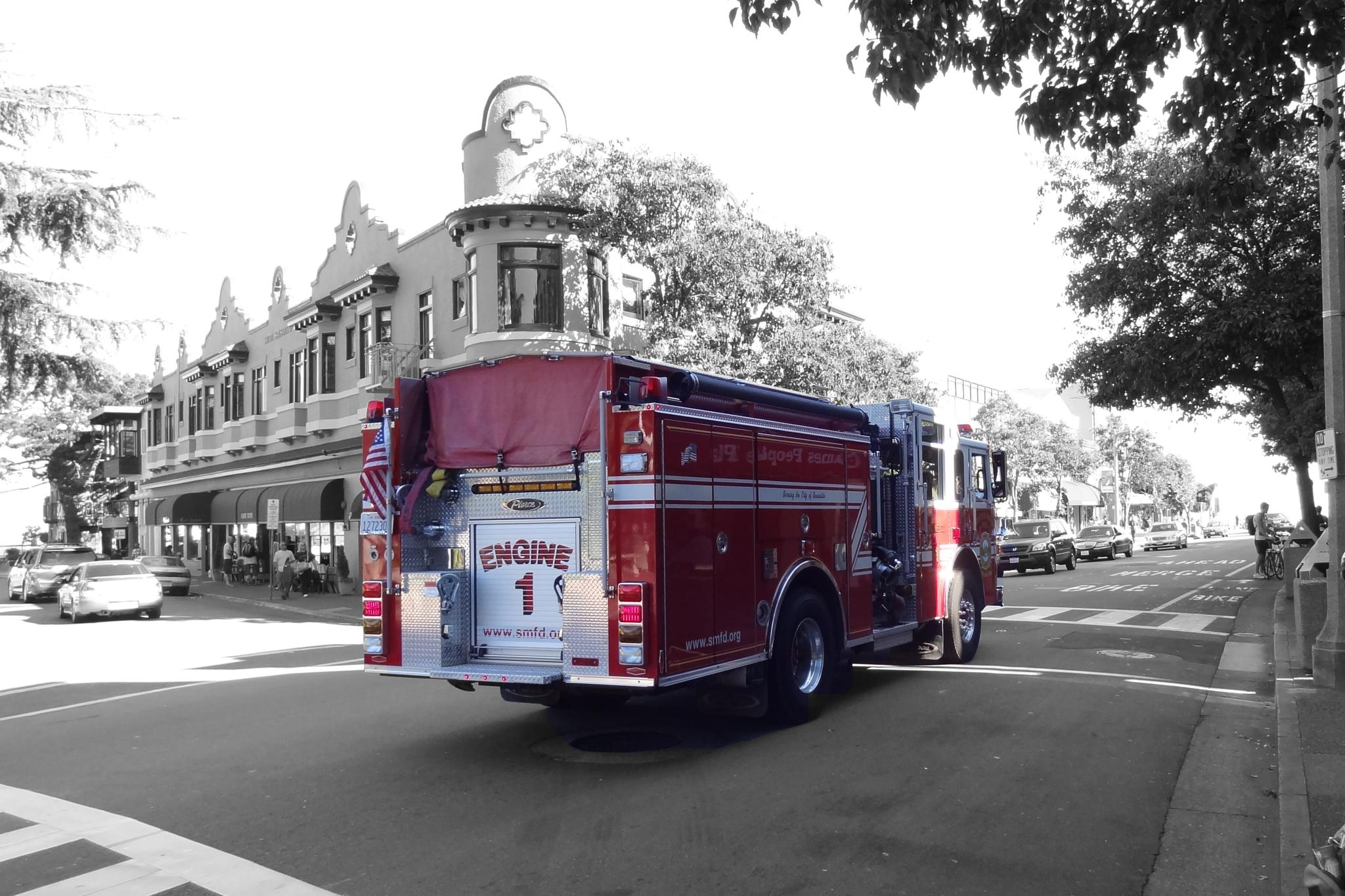 Sausalito fire engine rushing by by Diana du Parand