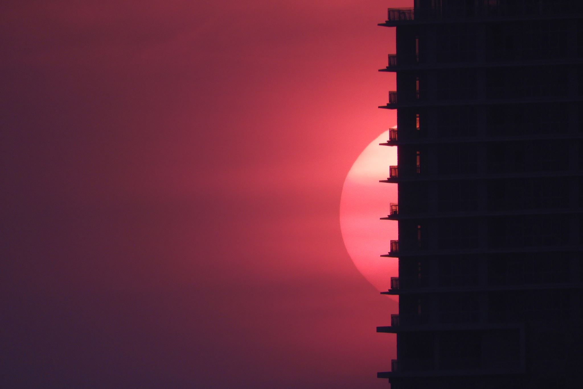Photo in Cityscape #home #sunset #redsky #sky #composition #details #balconies #goldenhour #photography #nature #naturephotography #red #pink #orange #silhouette