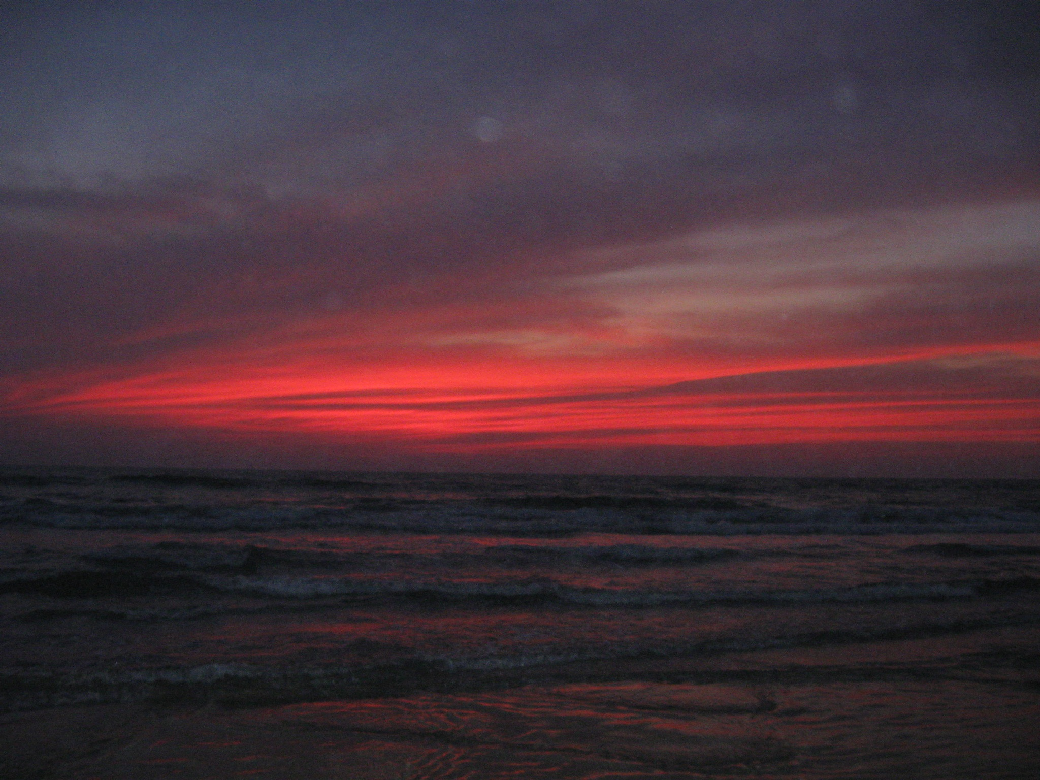 Photo in Sea and Sand #sky #sea #red #beach #colors