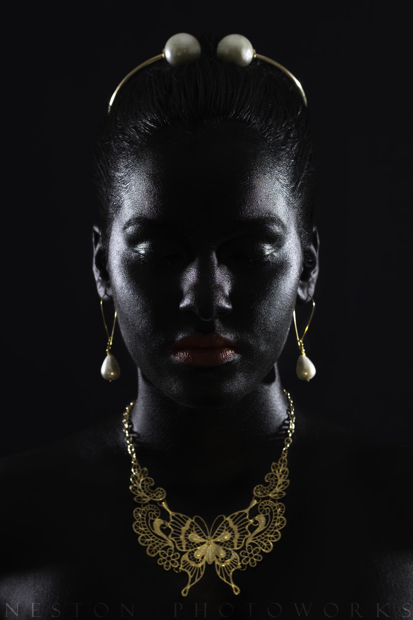 Gold Against Black.  by Neston Simoes