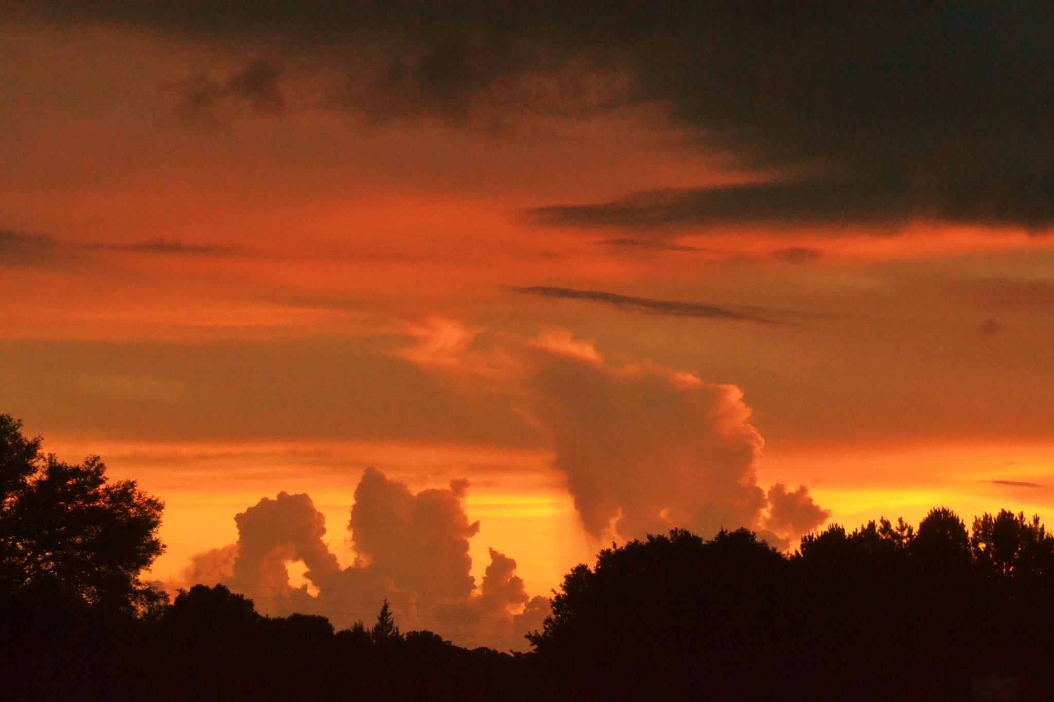 Sunset and Incoming Storm by Faye Kramer
