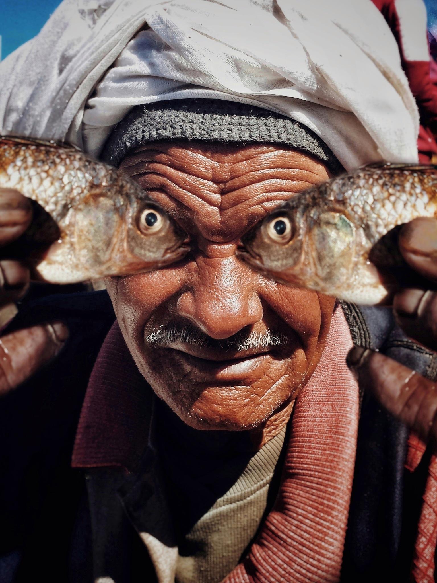 fish eye man by midoziko980