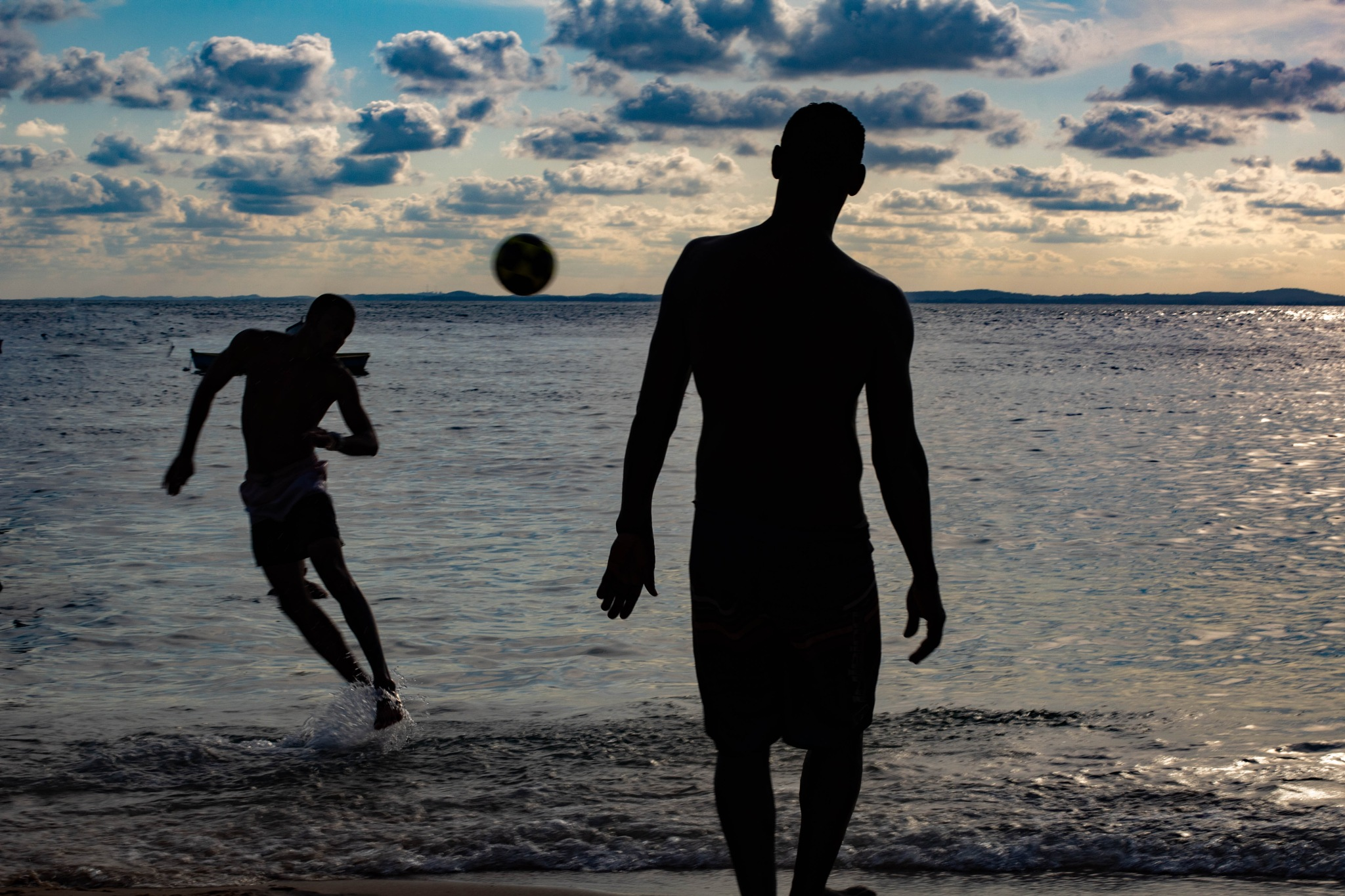 Soccer playing at the beach by Olívia Oseas Matar