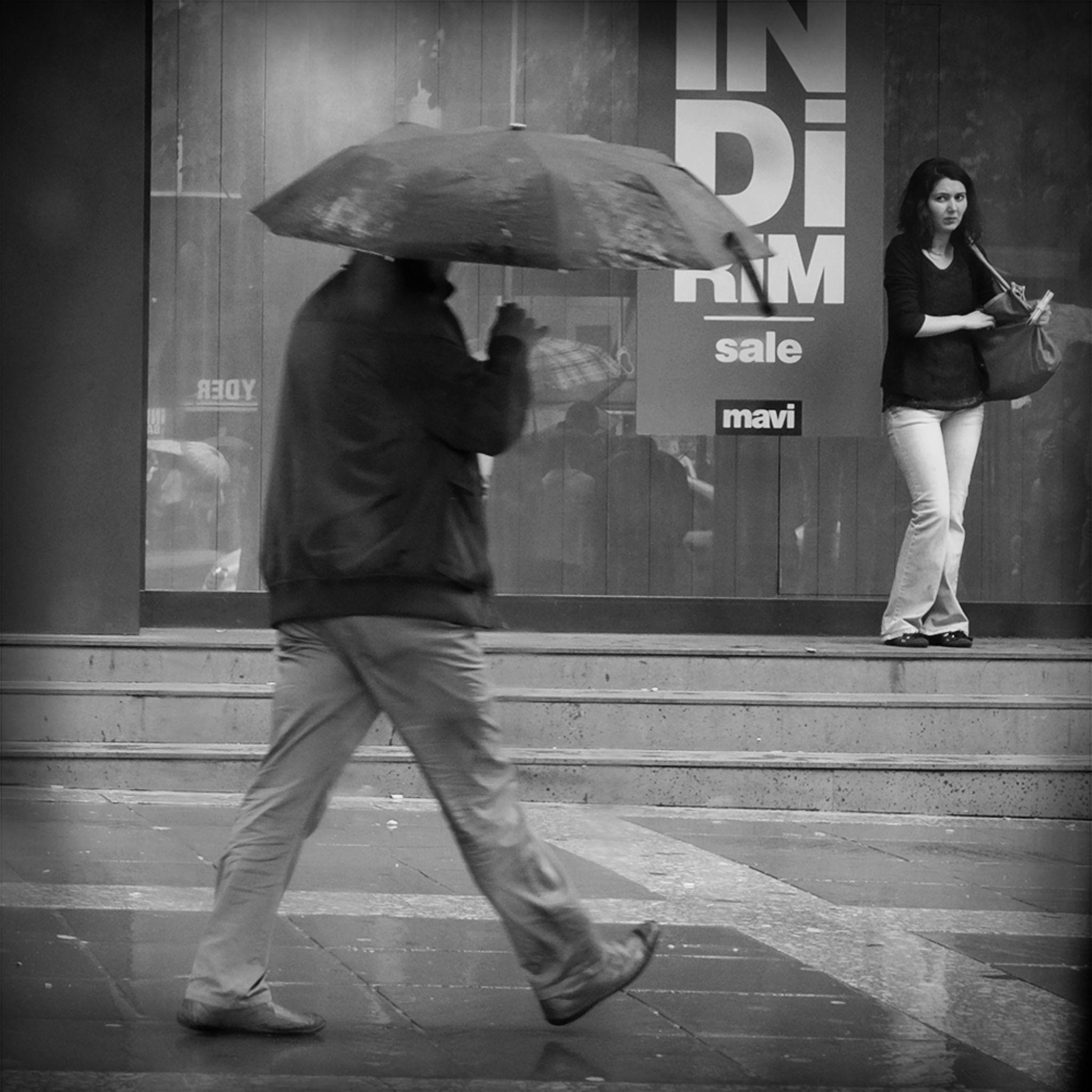 Rain, a woman a man by Ziya YILDIRIM