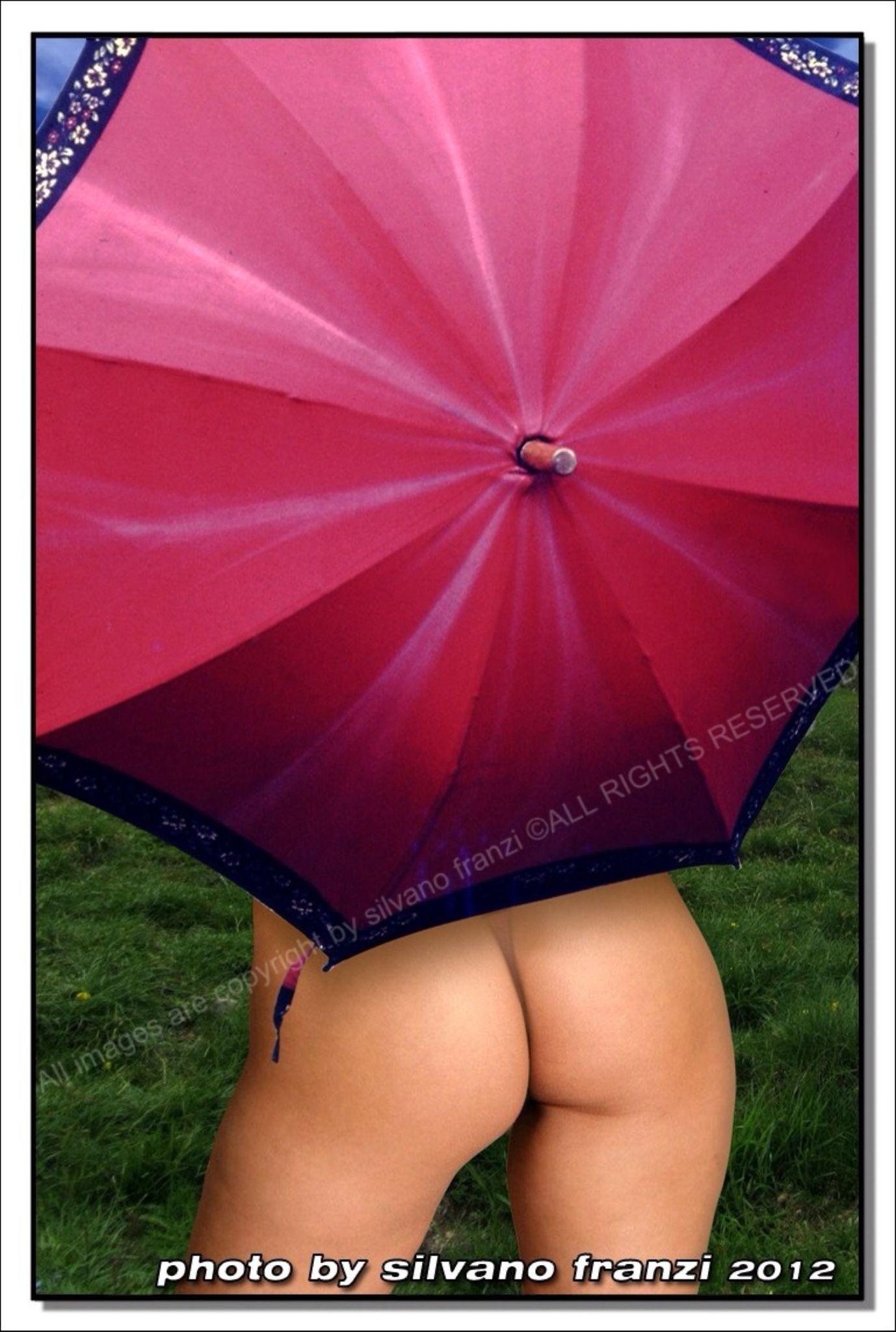 The red umbrella by SILVANO FRANZI