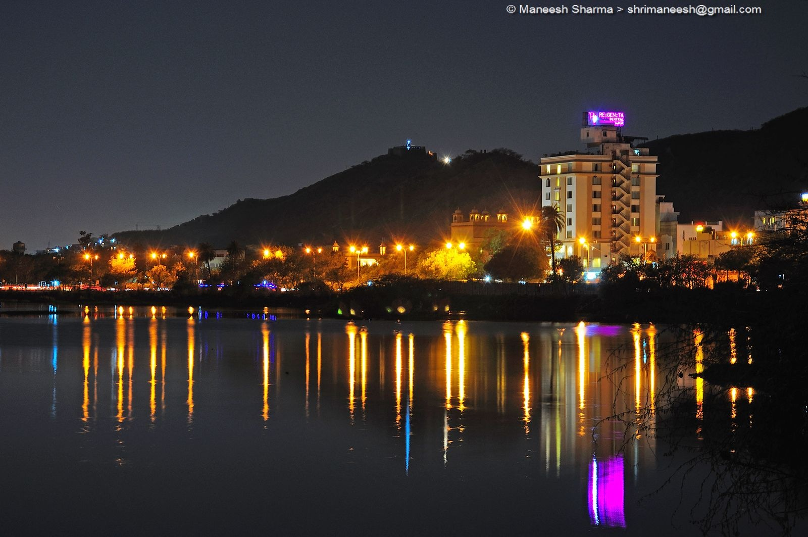 road lights reflect into Man sagar lake, Jaipur, India by Maneesh Sharma