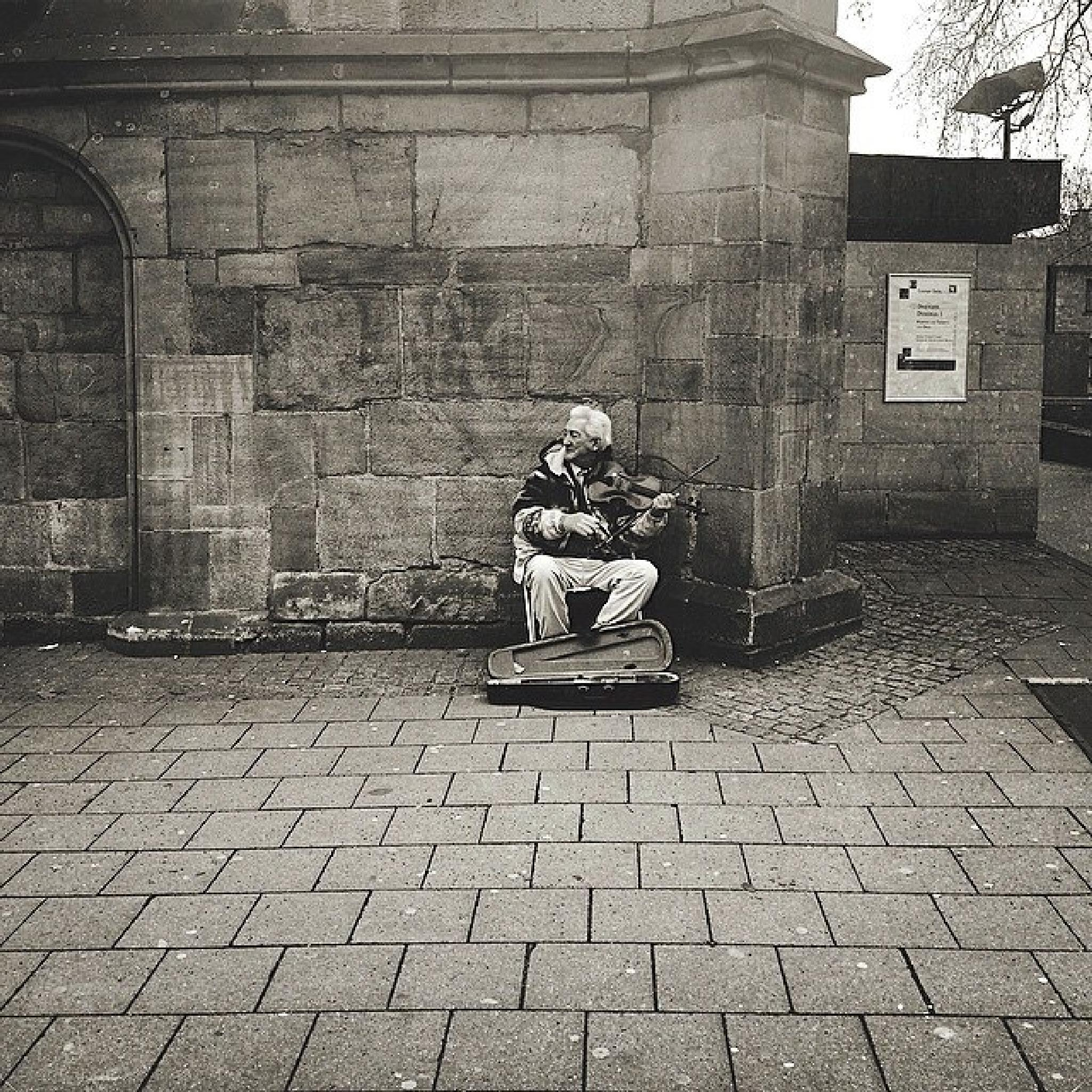 old man in the street gives a happy melody by Armin Mahmutovic