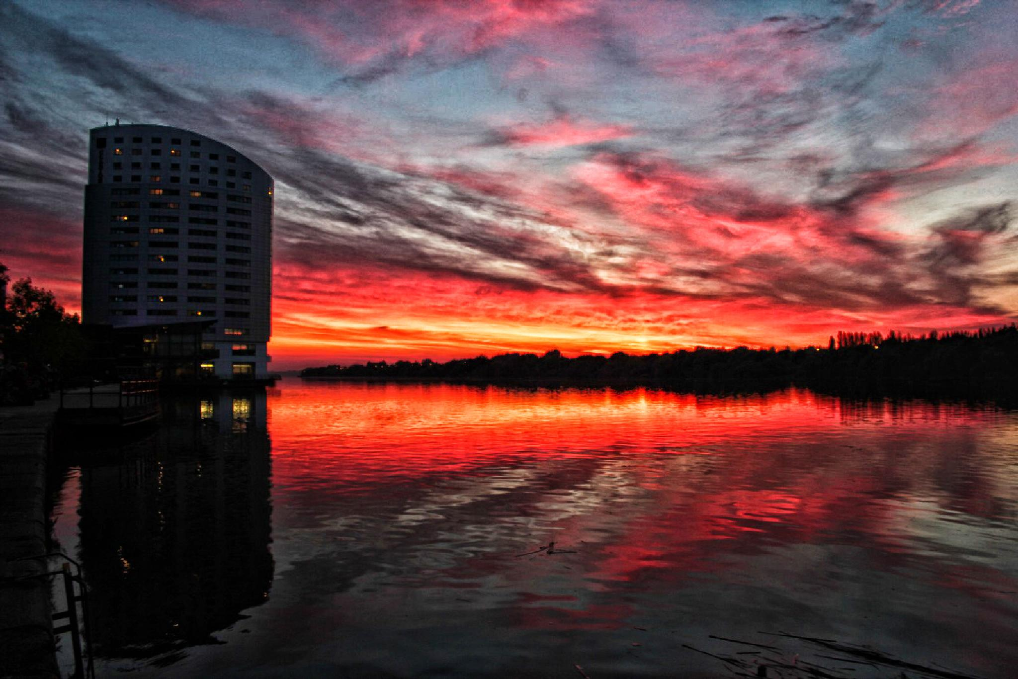 Clarion hotel on sunset over Shannon river - Limerick, Ireland by Krzysztof Luszczki