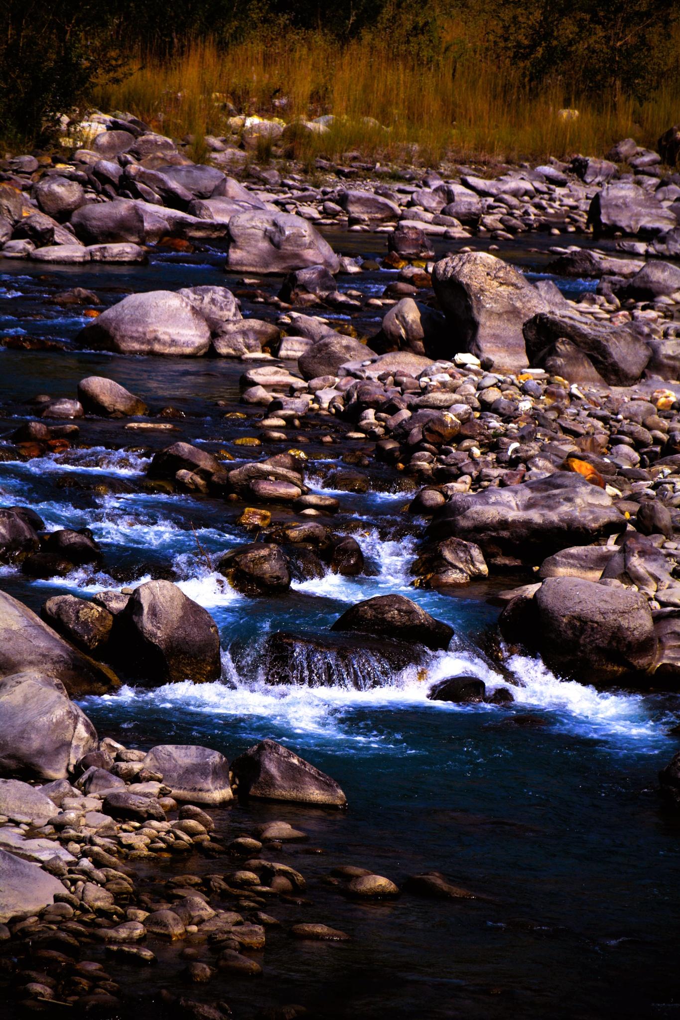 Flowing water by Shirish Bhaukajee