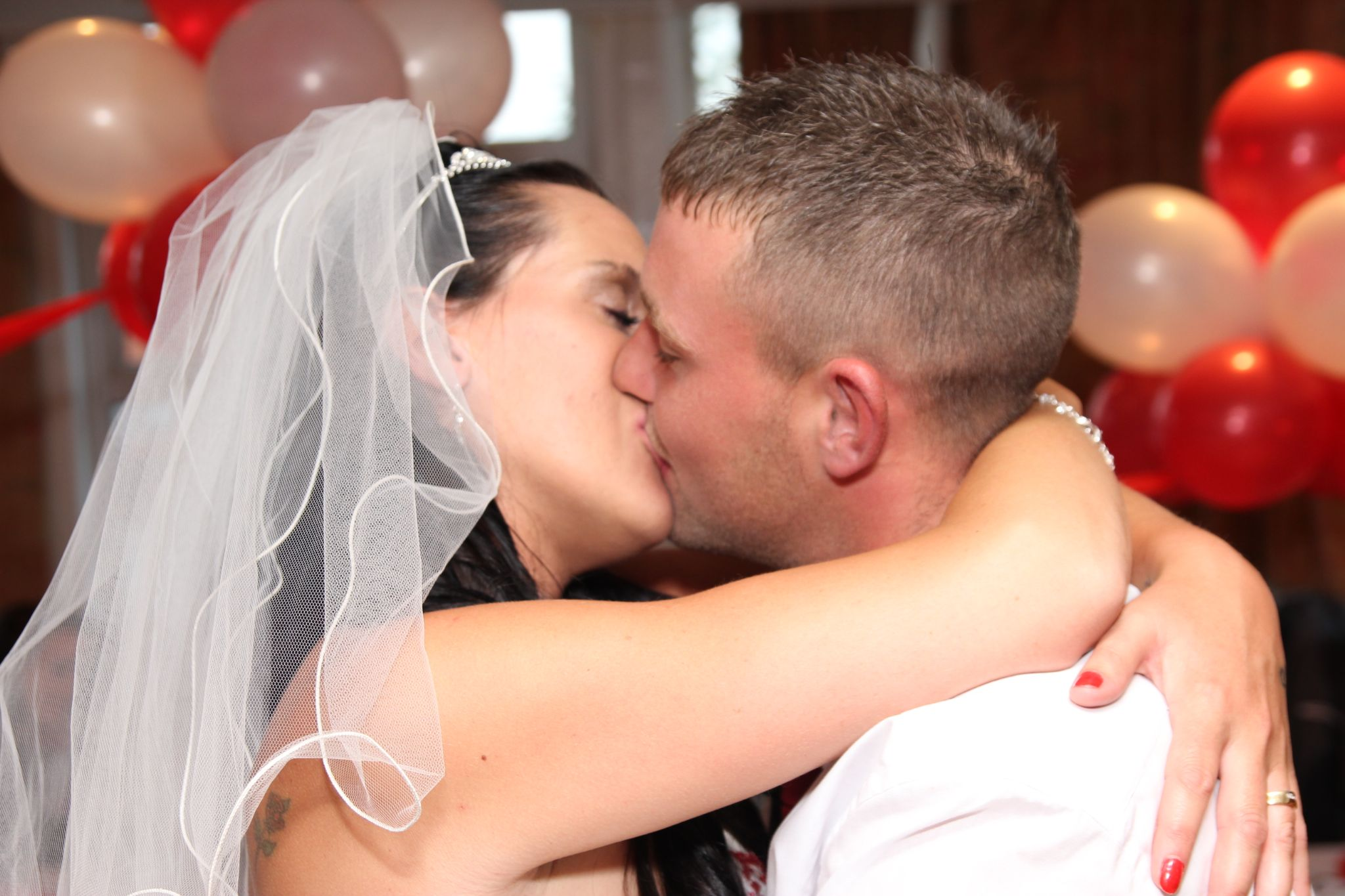 A kiss by Nige Photography