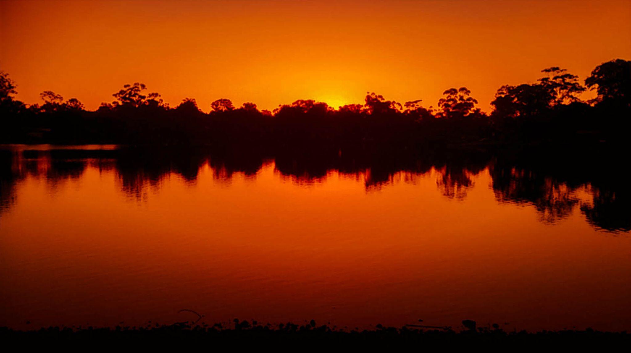 Laguna Lake after sunset by Sage Digital