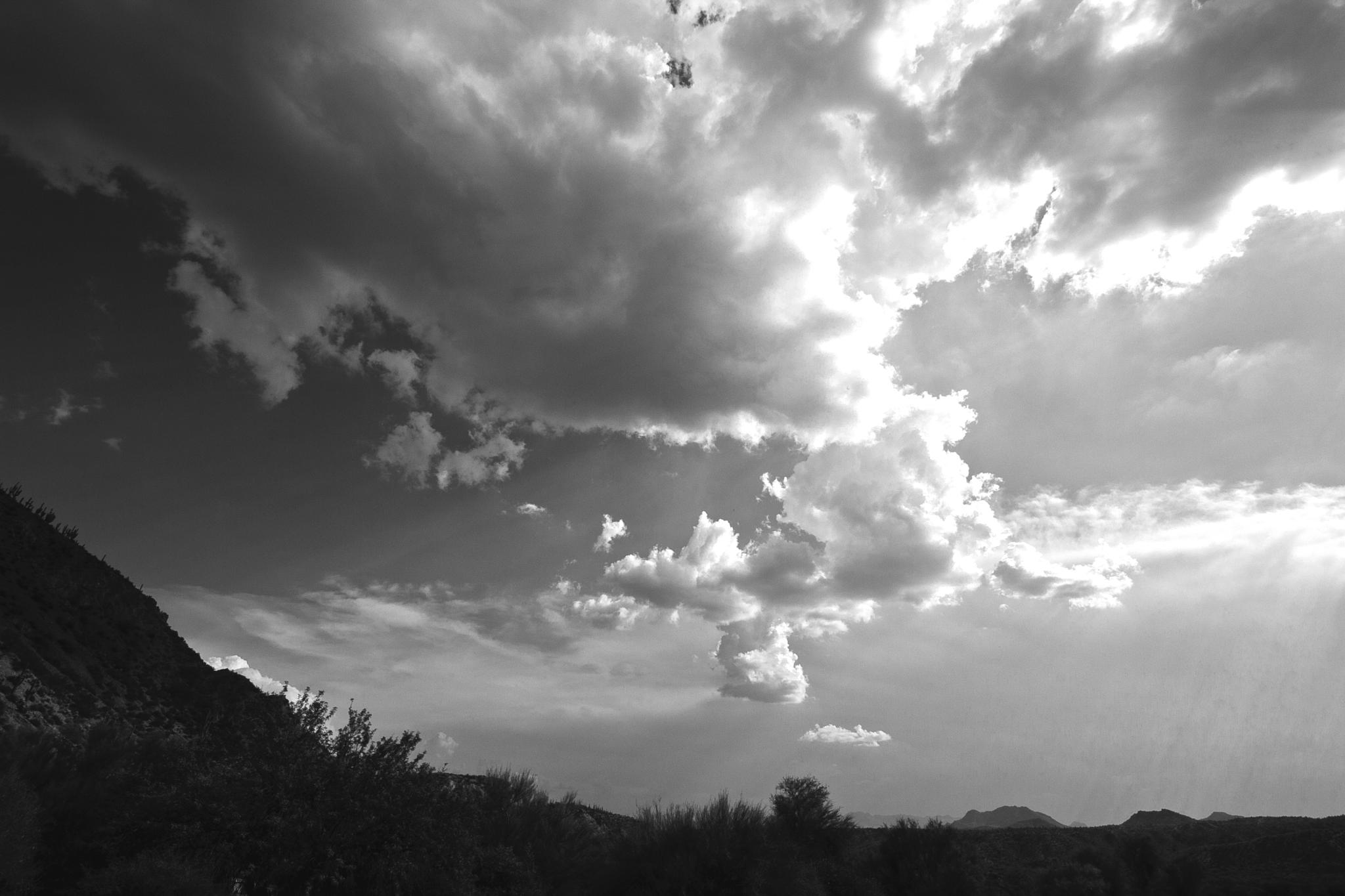 Photo in Black and White #clouds #desert #mountains #rays #storms