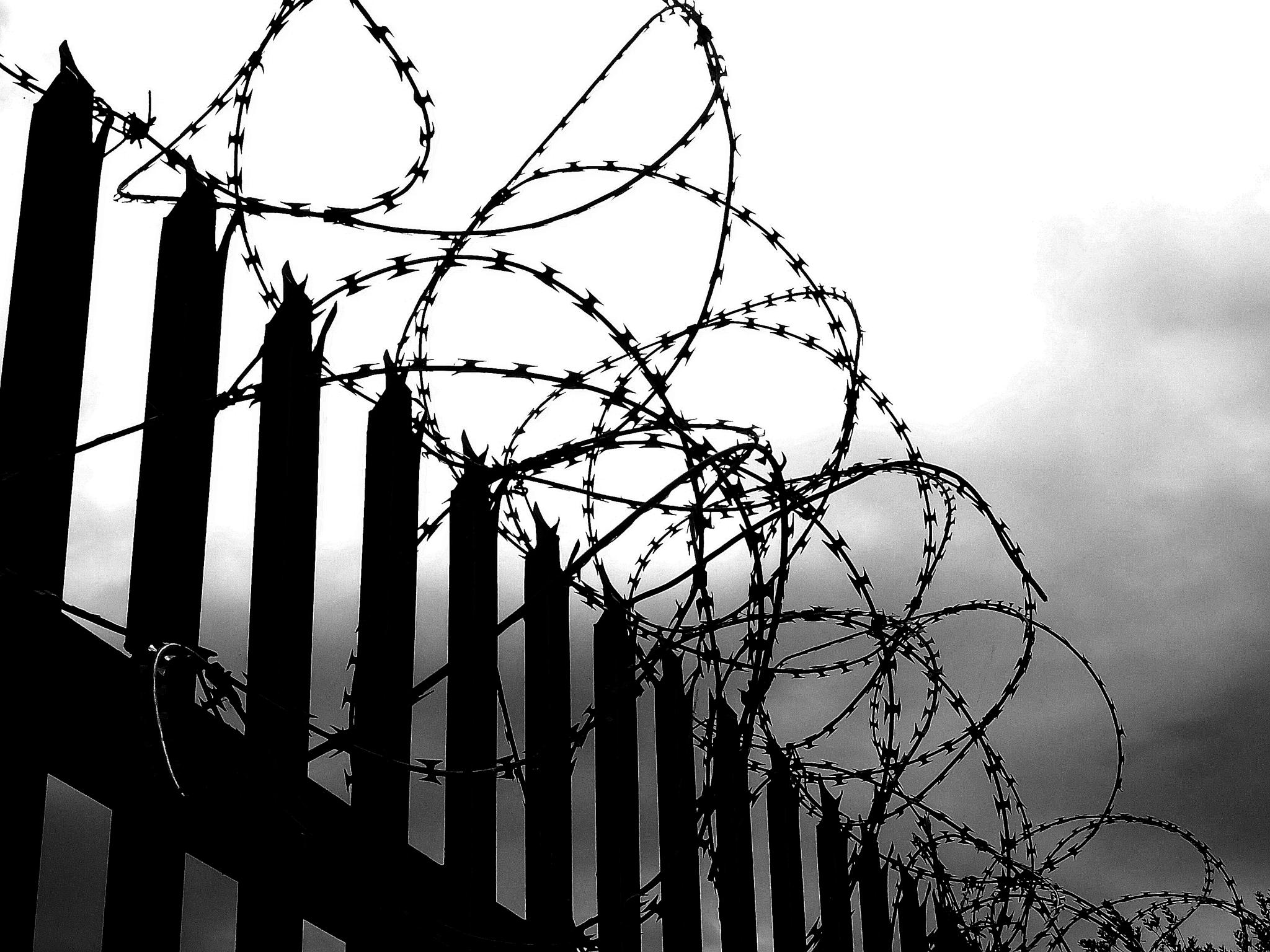 In or Out? Fence outside a factory in Hull UK. by WhiteArtPhotography