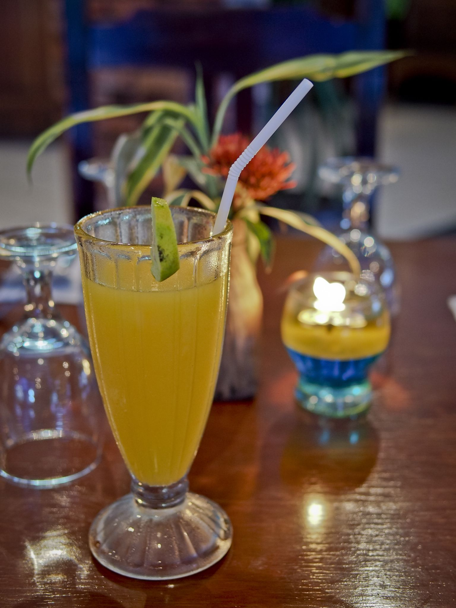 a cold glass of freshly squeezed orange juice by Victor Kam