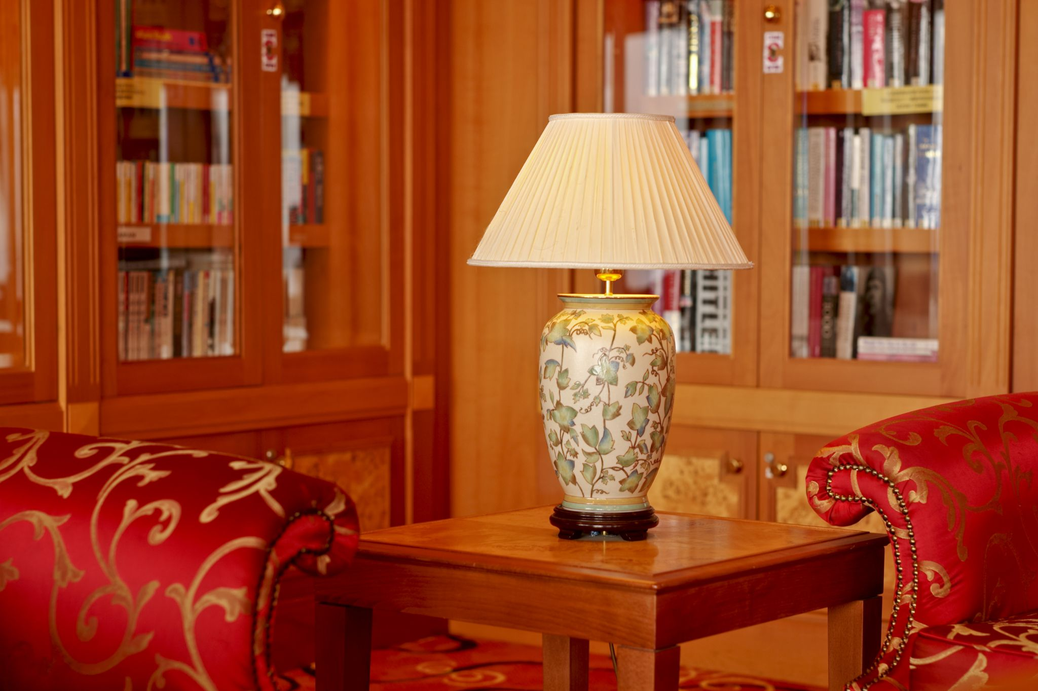 Table lamp in the library of the Serenade of the Seas by Victor Kam