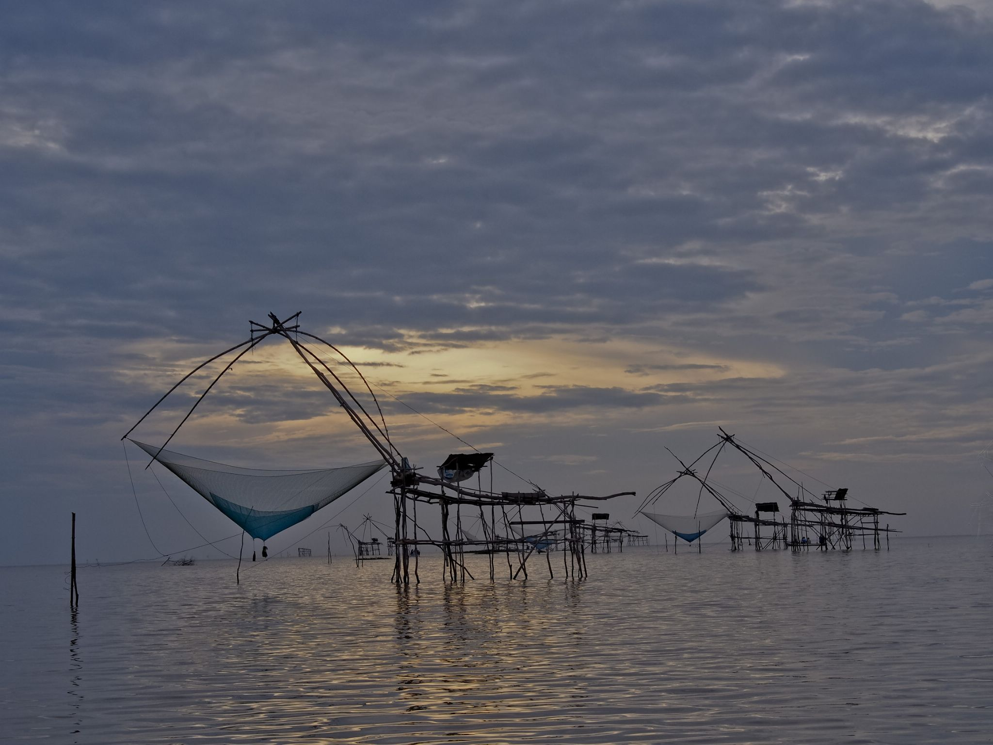 Fishing traps @ Phatthalung Lake in the early morning by Victor Kam