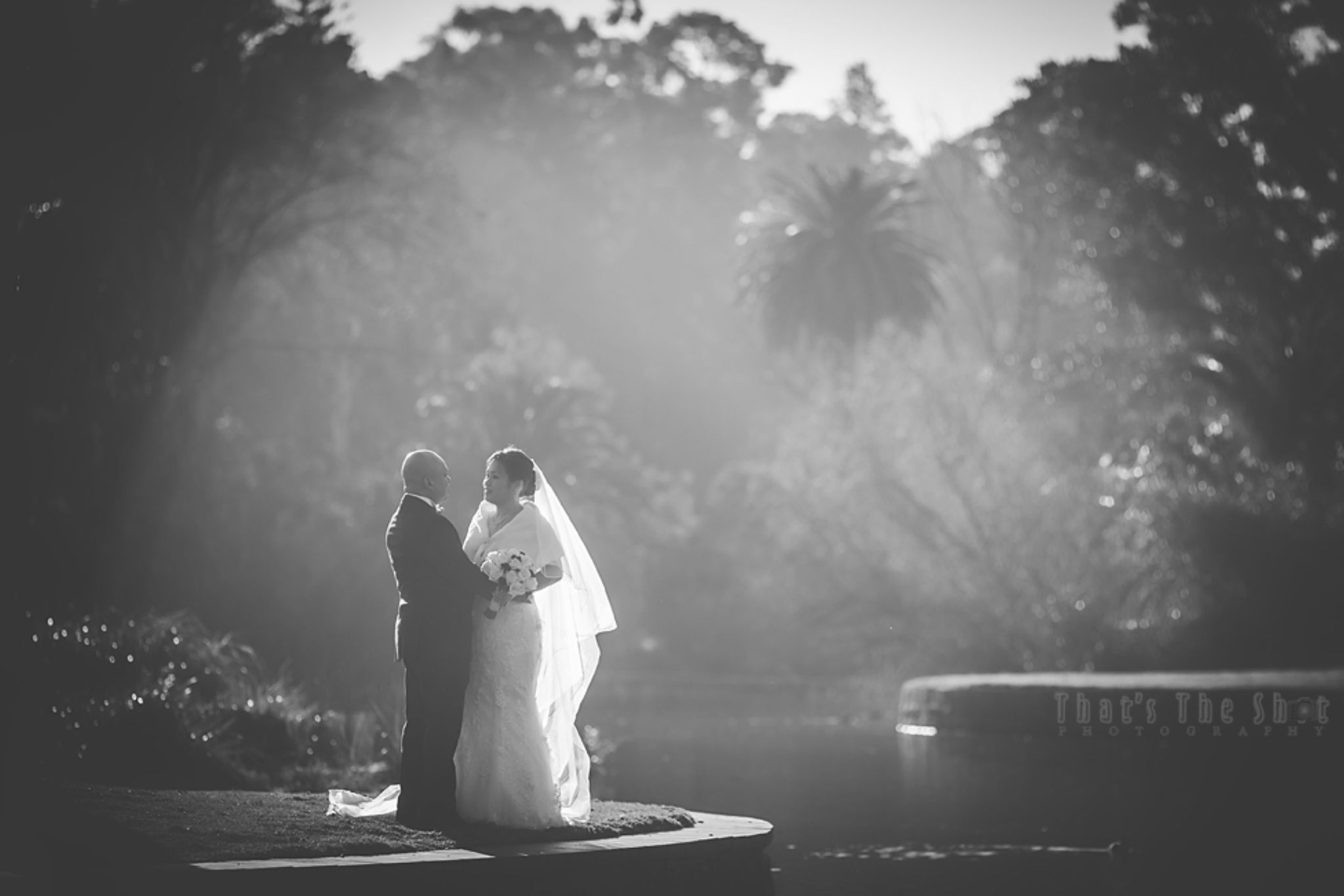 Wedding couple by the lake by ThatsTheShot