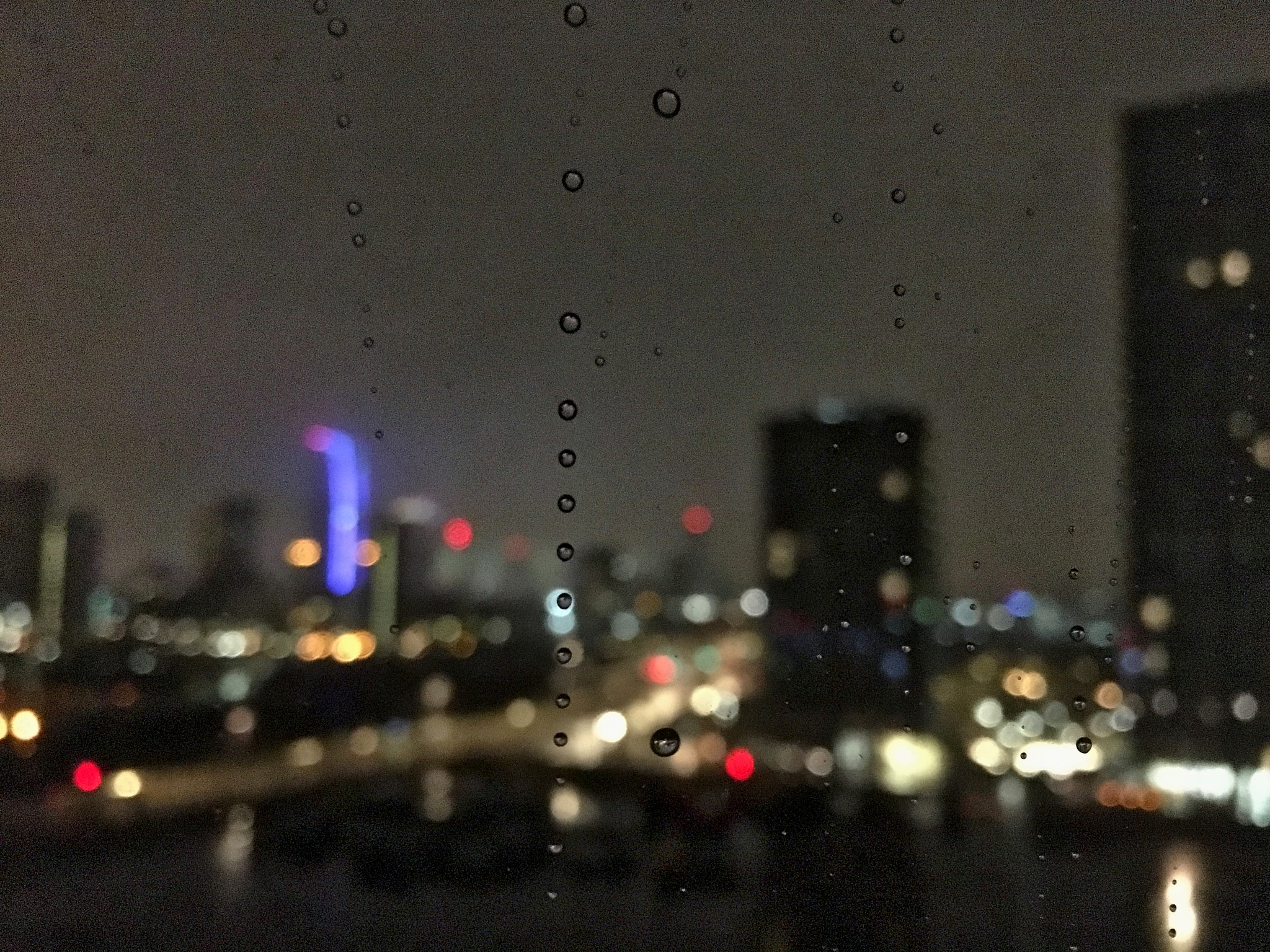Rain drops across the city by DJW