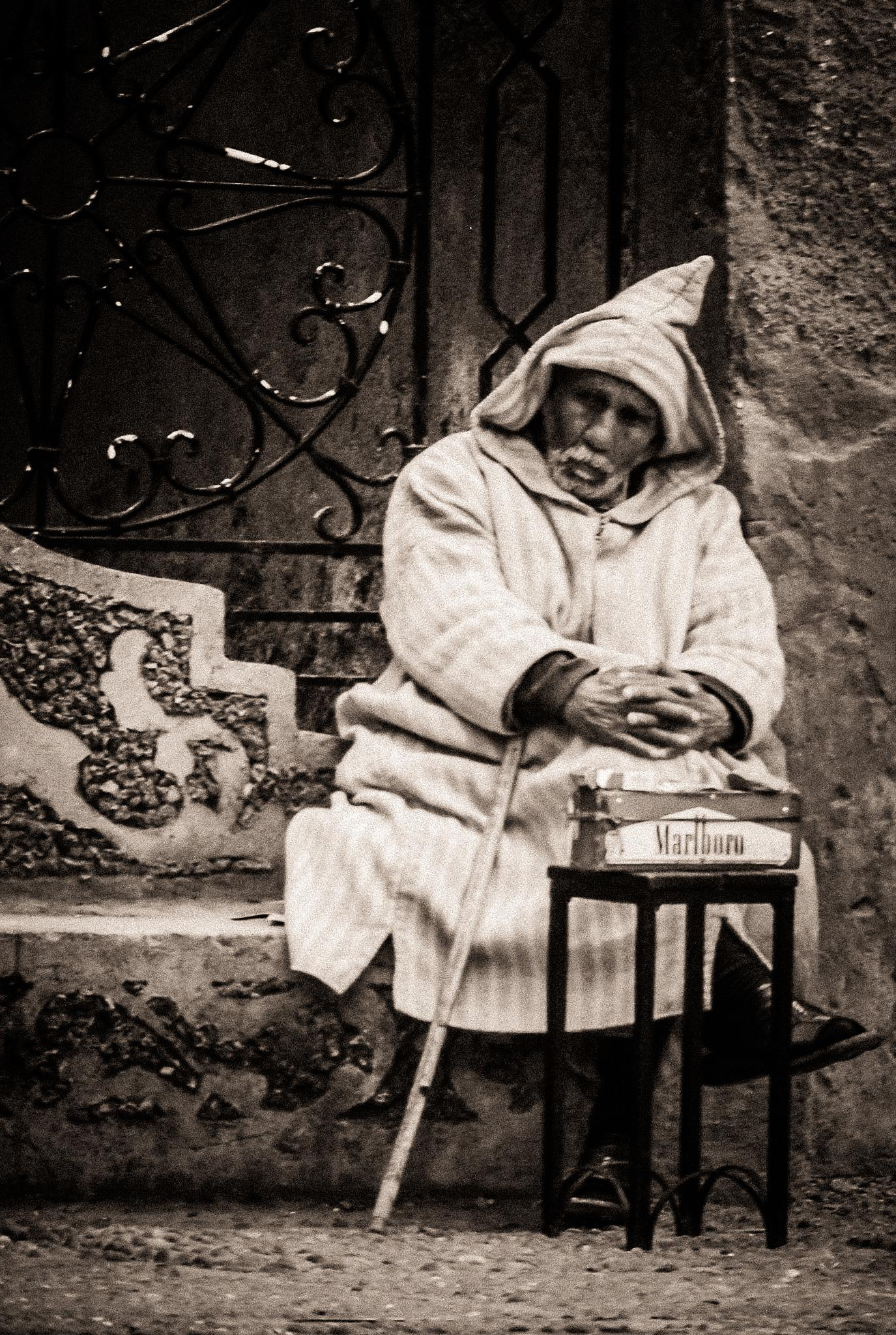 The cigarette vendor - Chaouen by Jean-Marc Schneider