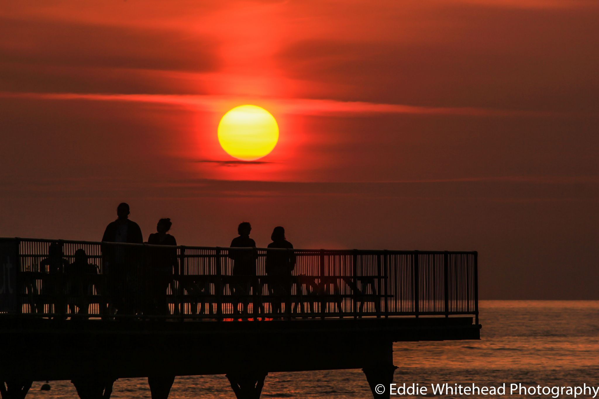 Sunset Over Aberystwyth Pier by eddiewhiteheadphotography