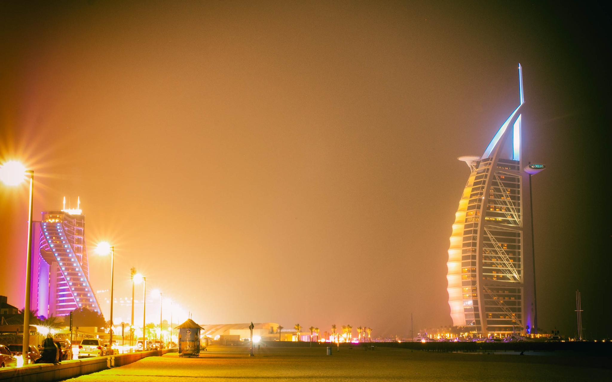 Burj Al-Arab and Jumeirah Beach Hotel at night by hayleyholloway1969