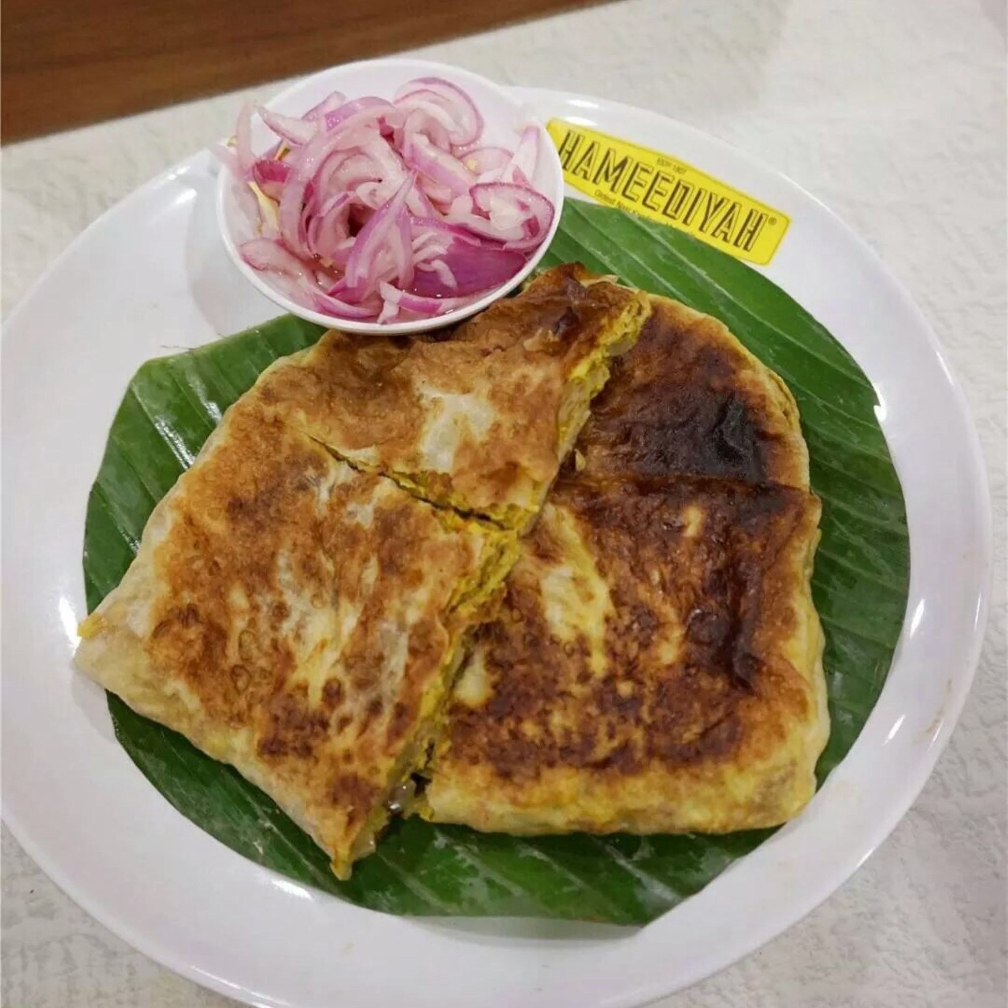 Murtabak (egg with meat cooked omelette style) dipped in curry by stefnigel