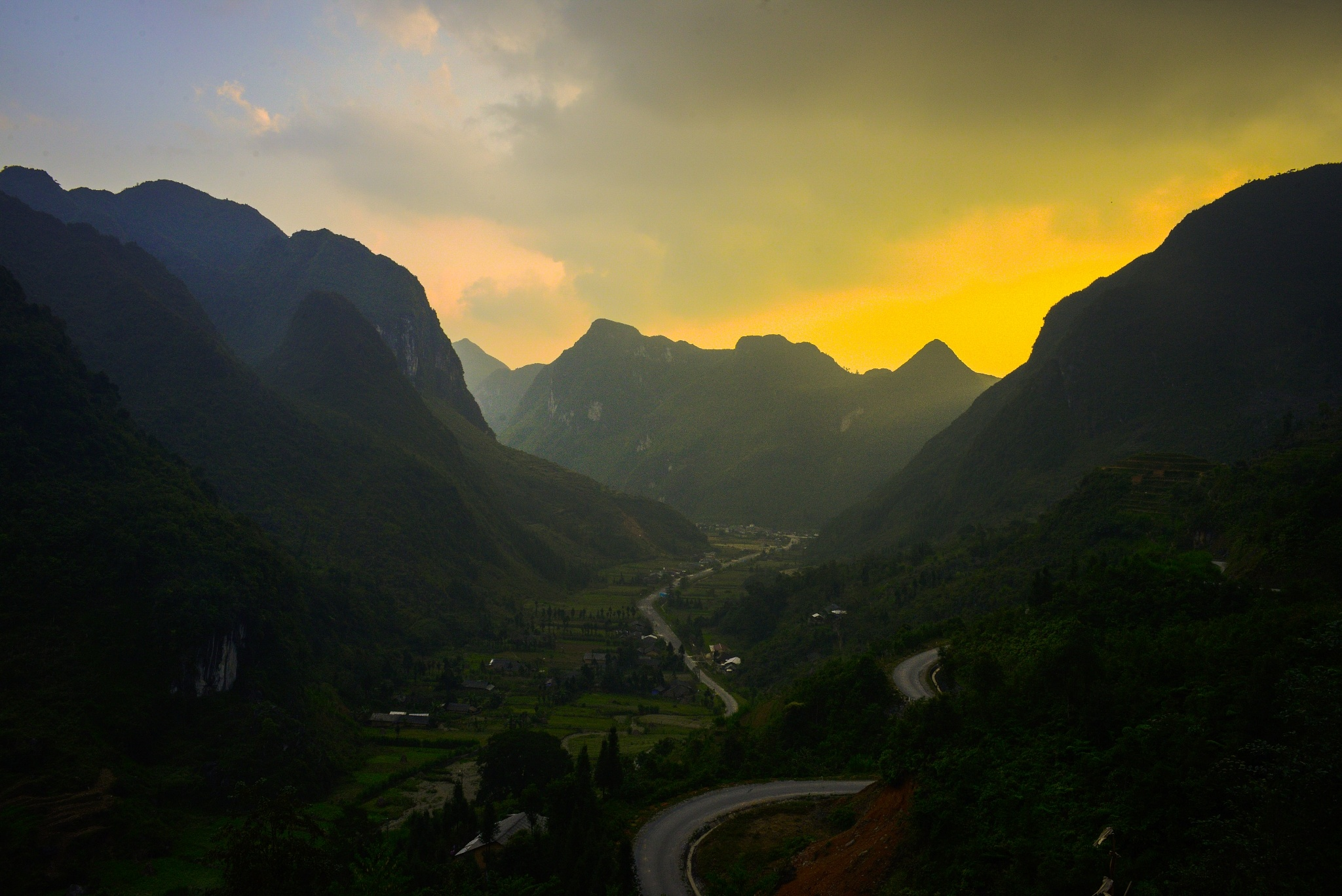 Sunset over a valley by Cuong NM