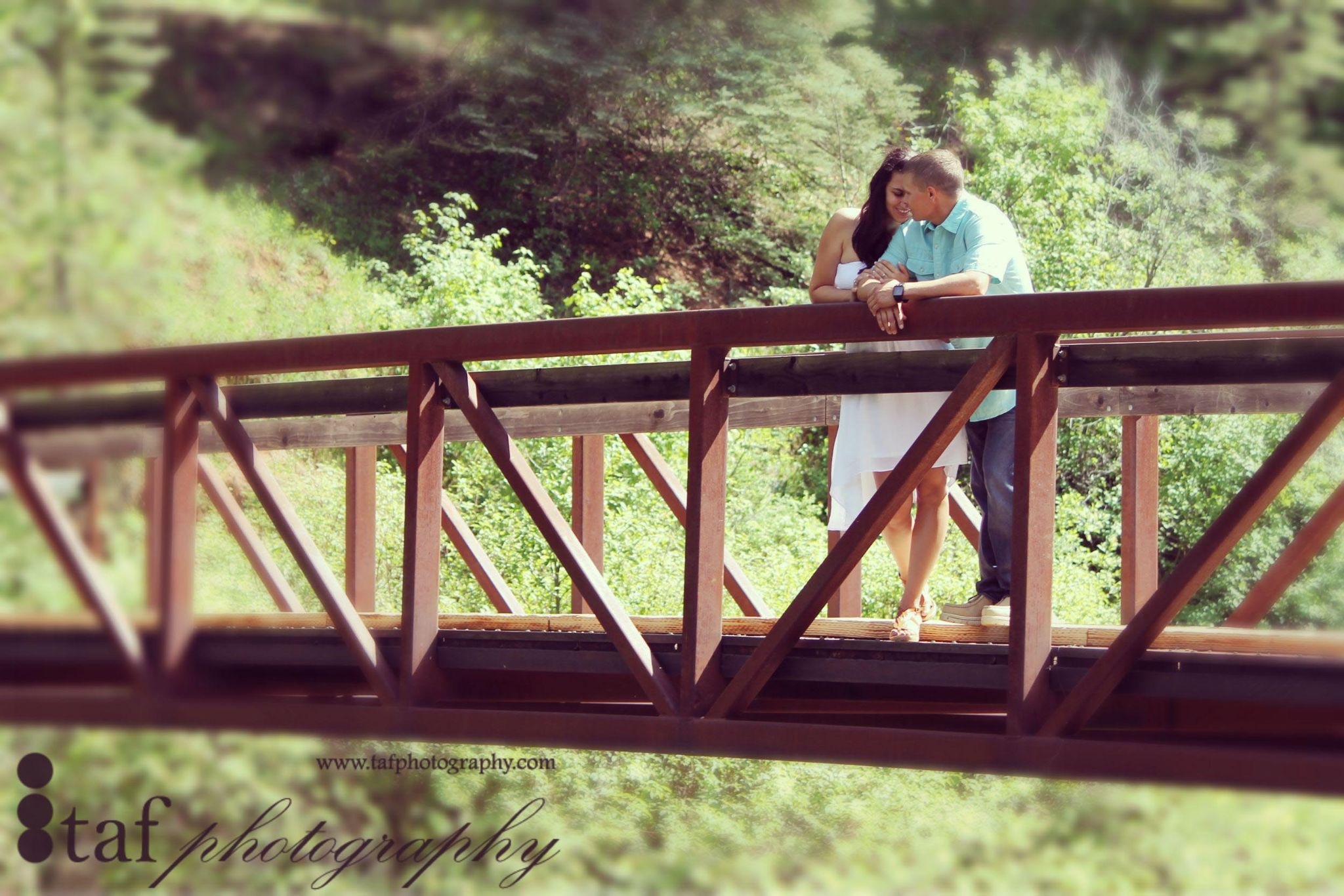 Couple on bridge by Rachel Folmar