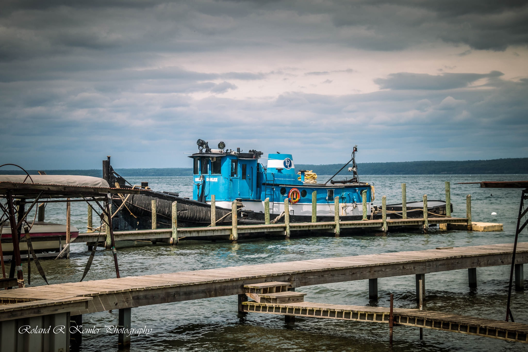 Fishing boat on Seneca lake by Roland R Kemler