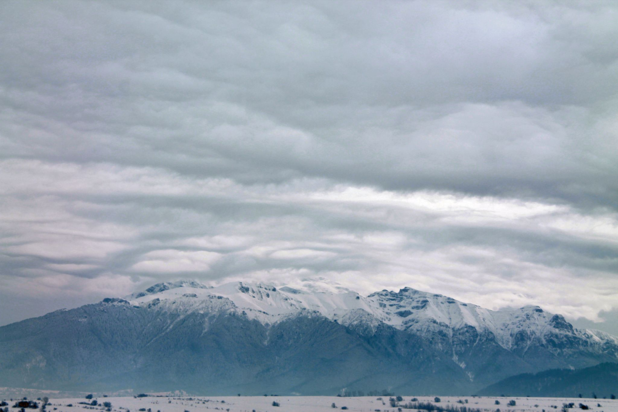 Snow over the mountains by gabi.striblea