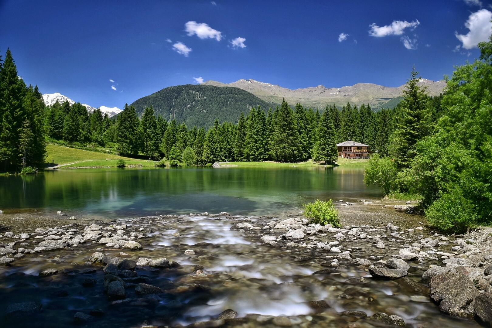 Mountain lake in Italy by joostlagerweij