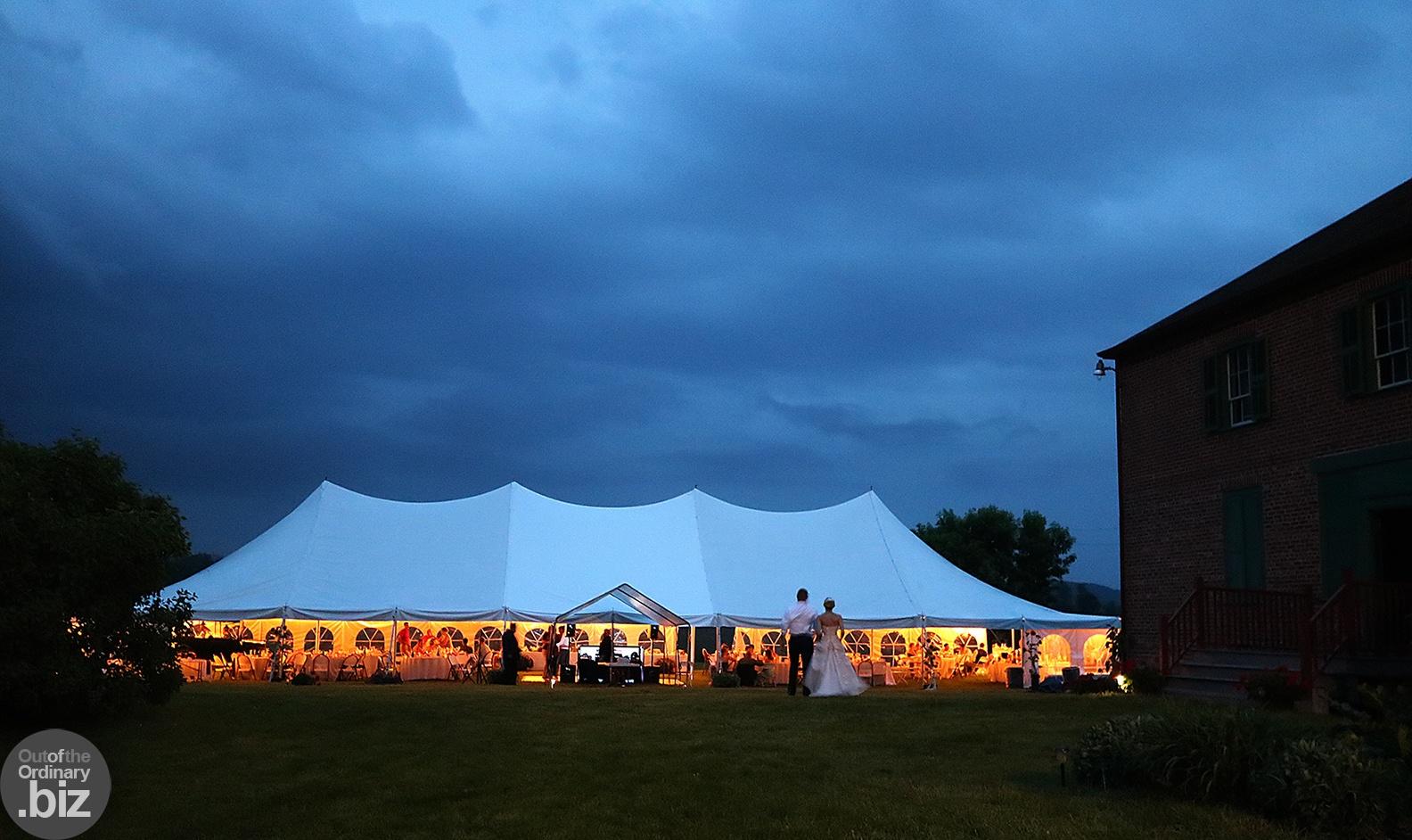 Photo in Wedding #wedding #bride #groom #tent #night #evening #dress #light #brick #haunted