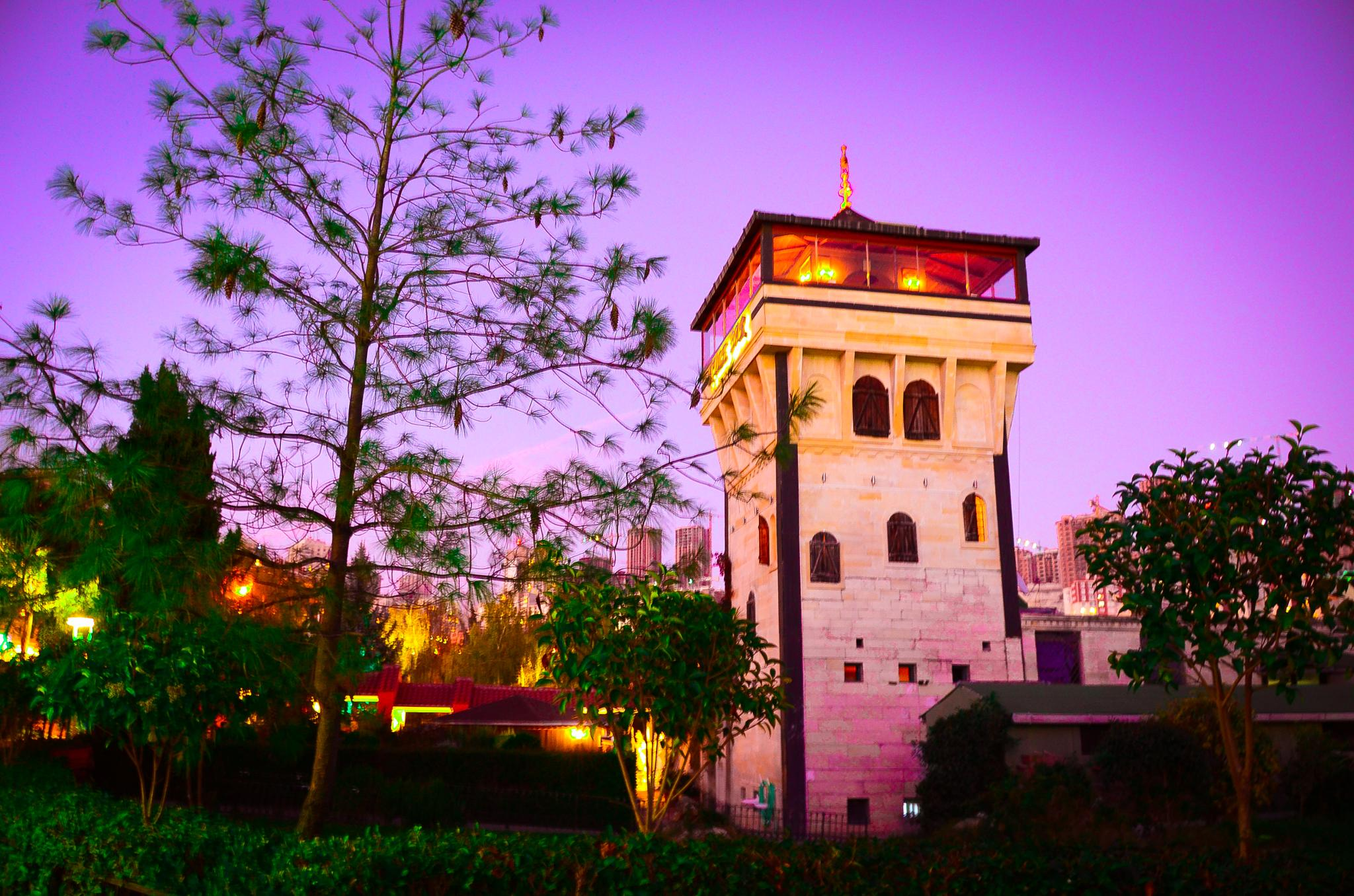 Tower at sunset time. by Saly.Wanli
