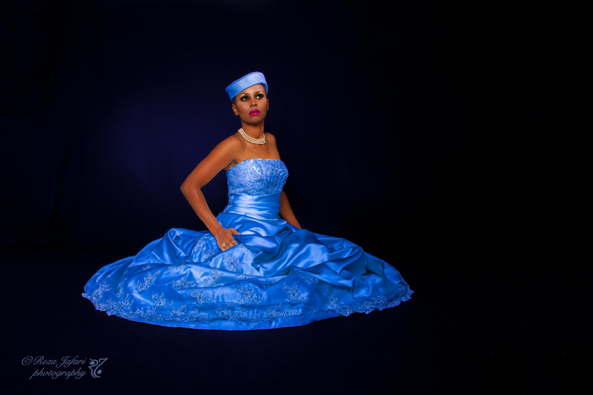 Photo in Fashion #female #woman #fashion #clothing #brown skin #hat #blue dress #dress #appearance #make up