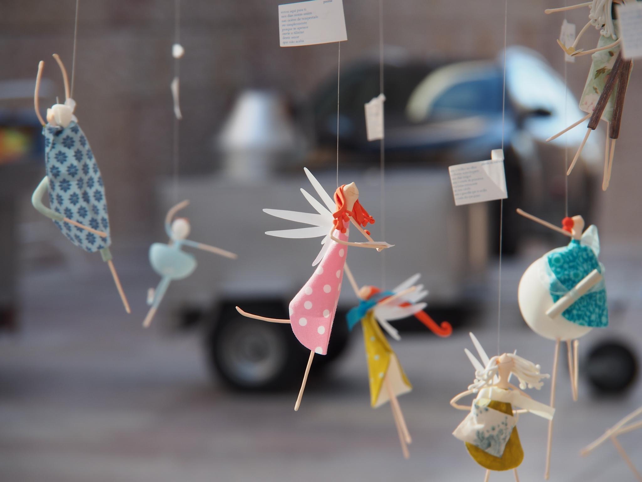 Suspended dancers by Carlos MG Reis