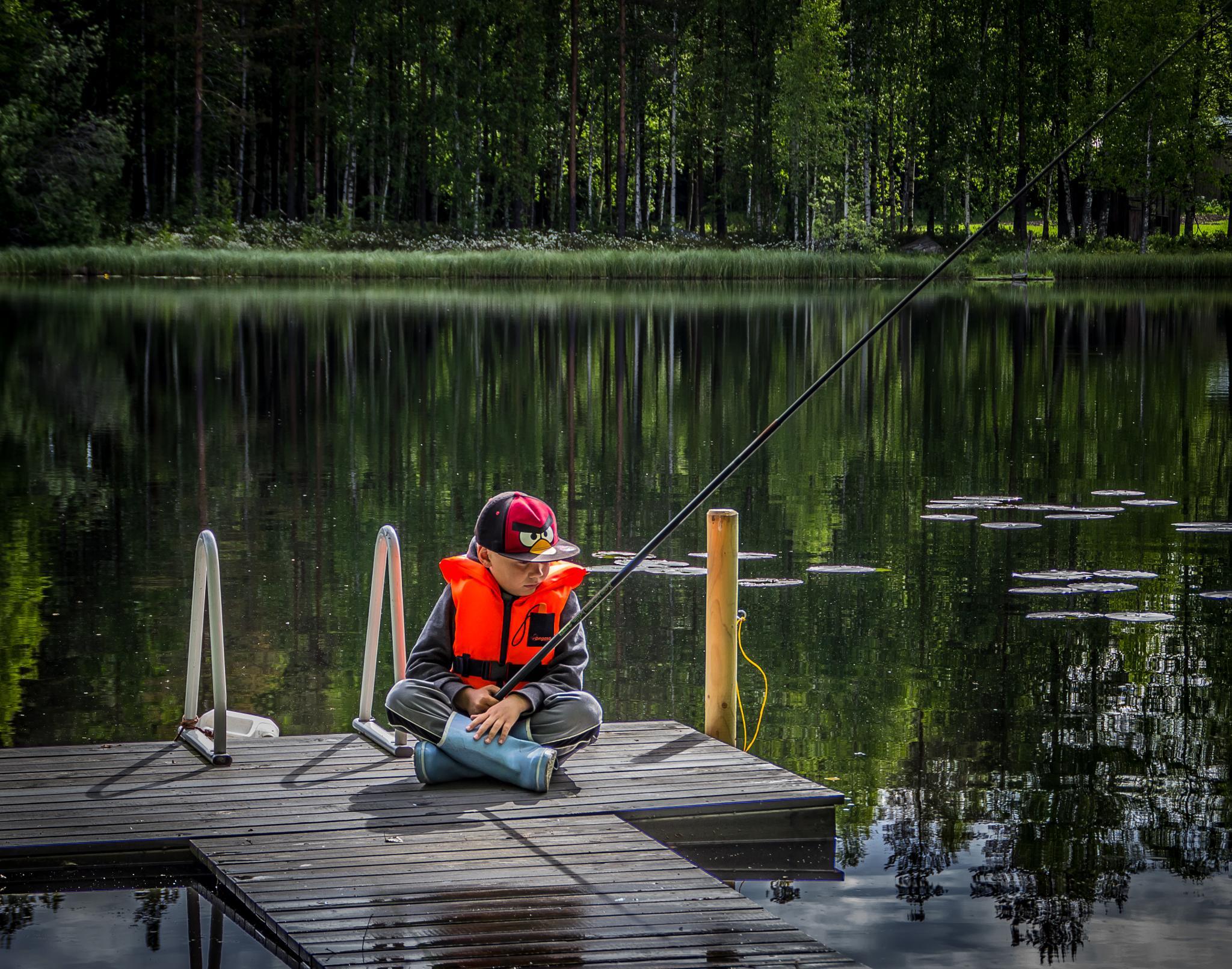 Boy is fishing by SakariPartio