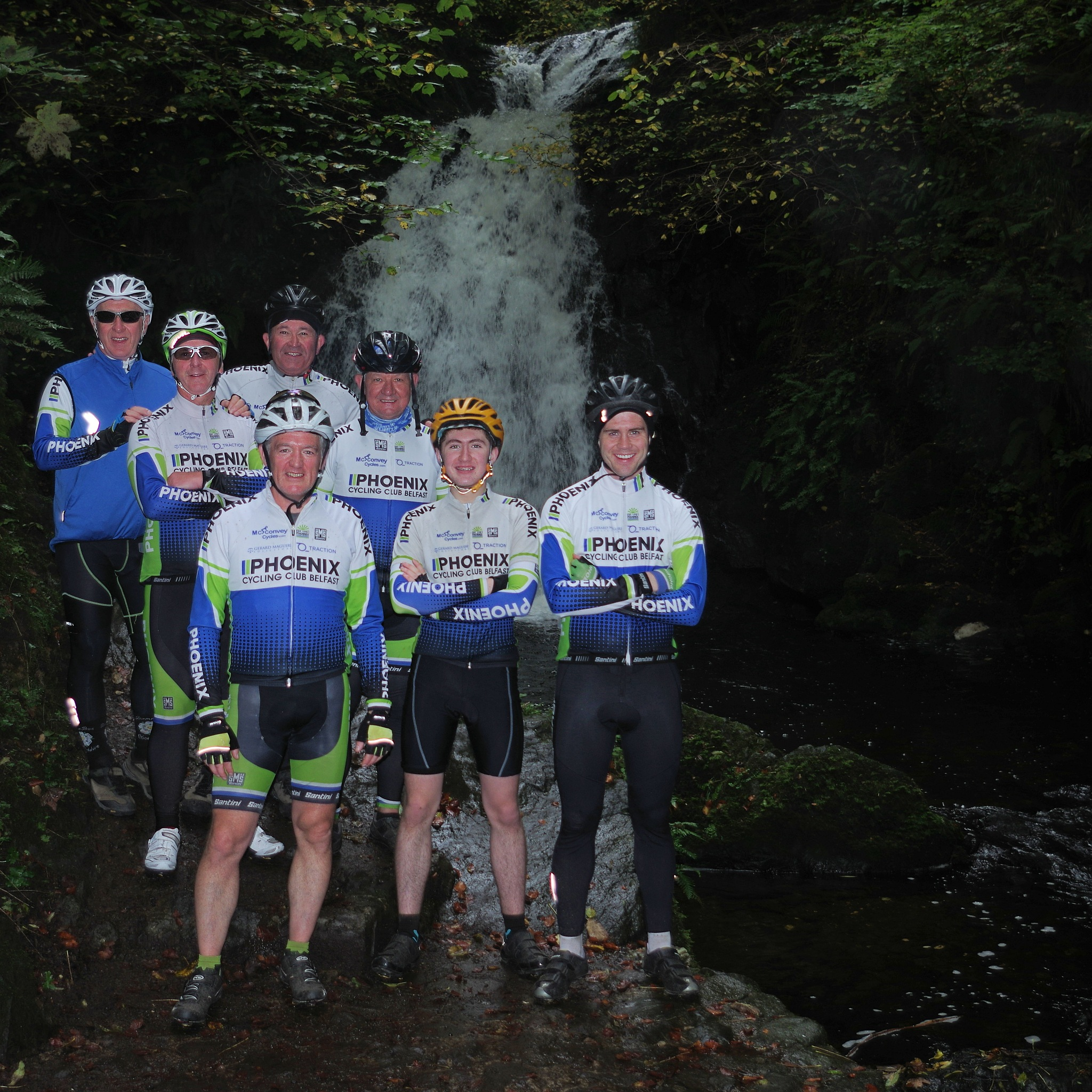 Cyclists by the waterfall by David Stewart