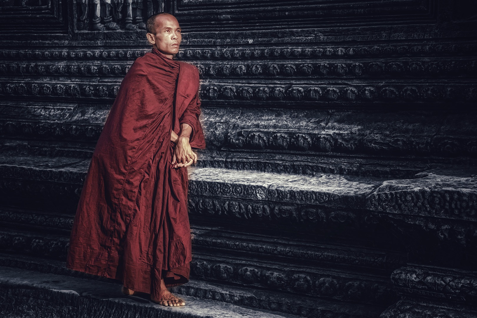 The monk meets the dawn in Angkor Wat by Max Mishin