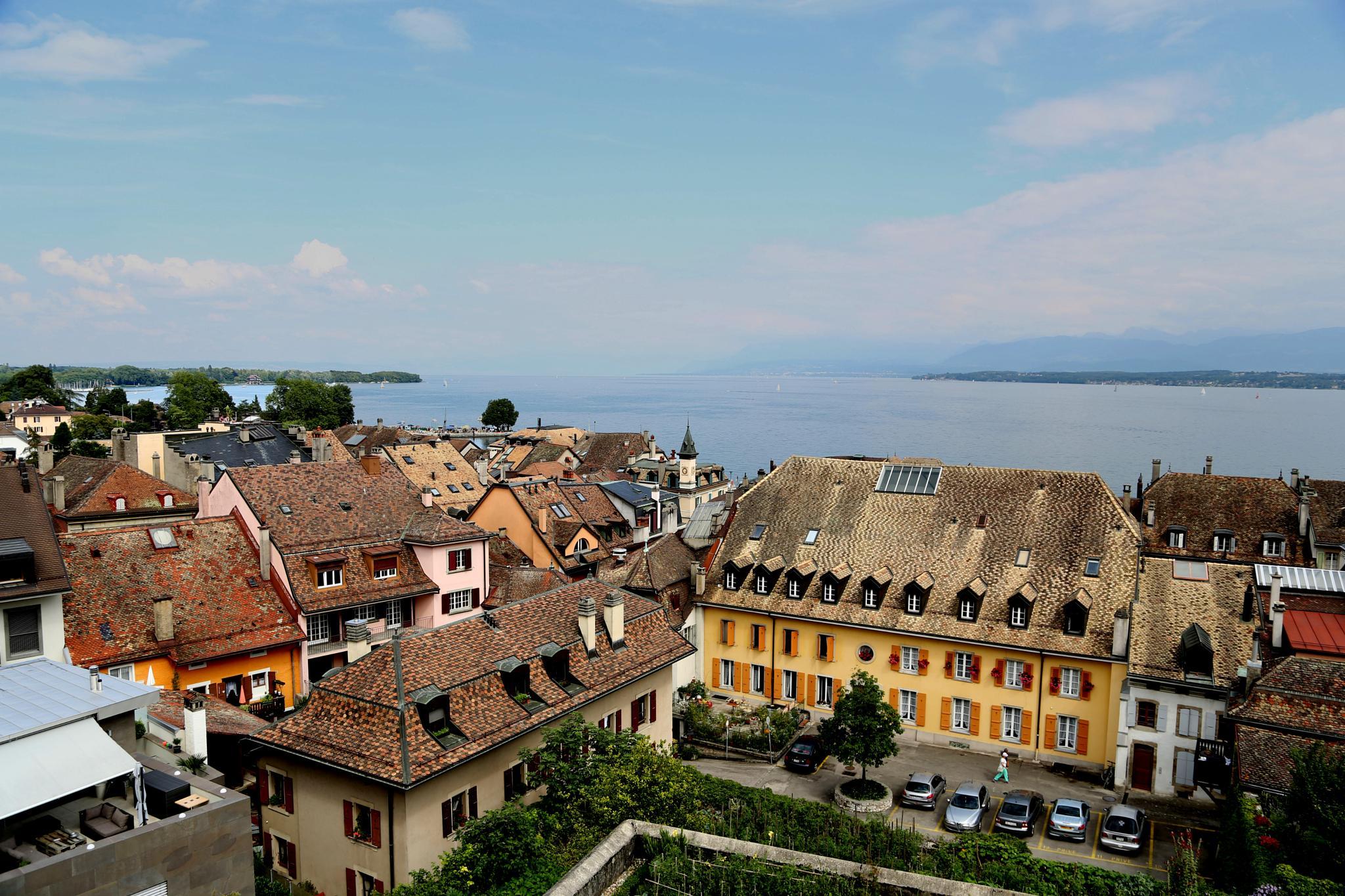 A View of Lake Geneva over the Roof Tops by Atila_Yumusakkaya