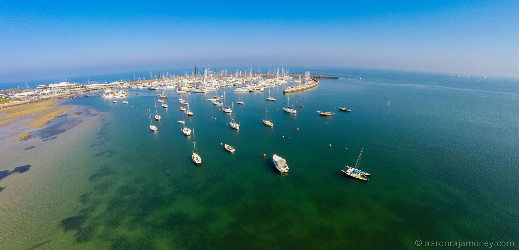 Low aerial flight towards the yacht club by aaron