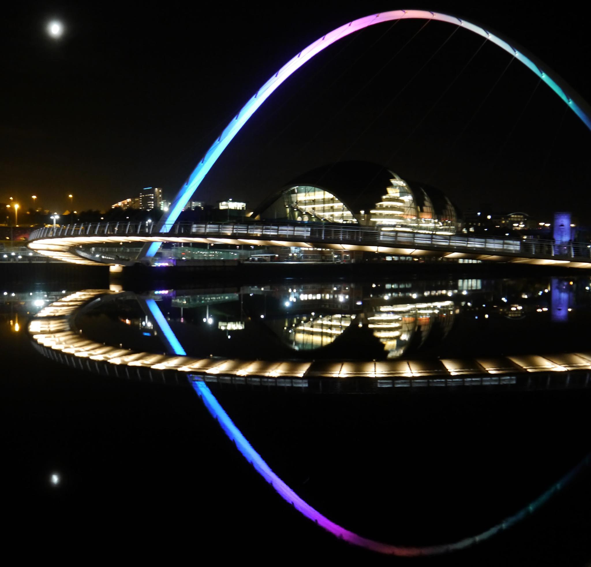 Gateshead Millennium Bridge and moon Reflection. by Darren Turner
